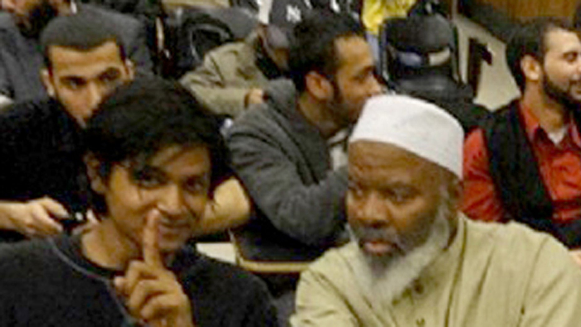 May 3, 2012: This handout photo provided by Jamill Noorata shows Shamiur Rahman, left, sitting with Siraj Wahhaj at John Jay Community College in New York.