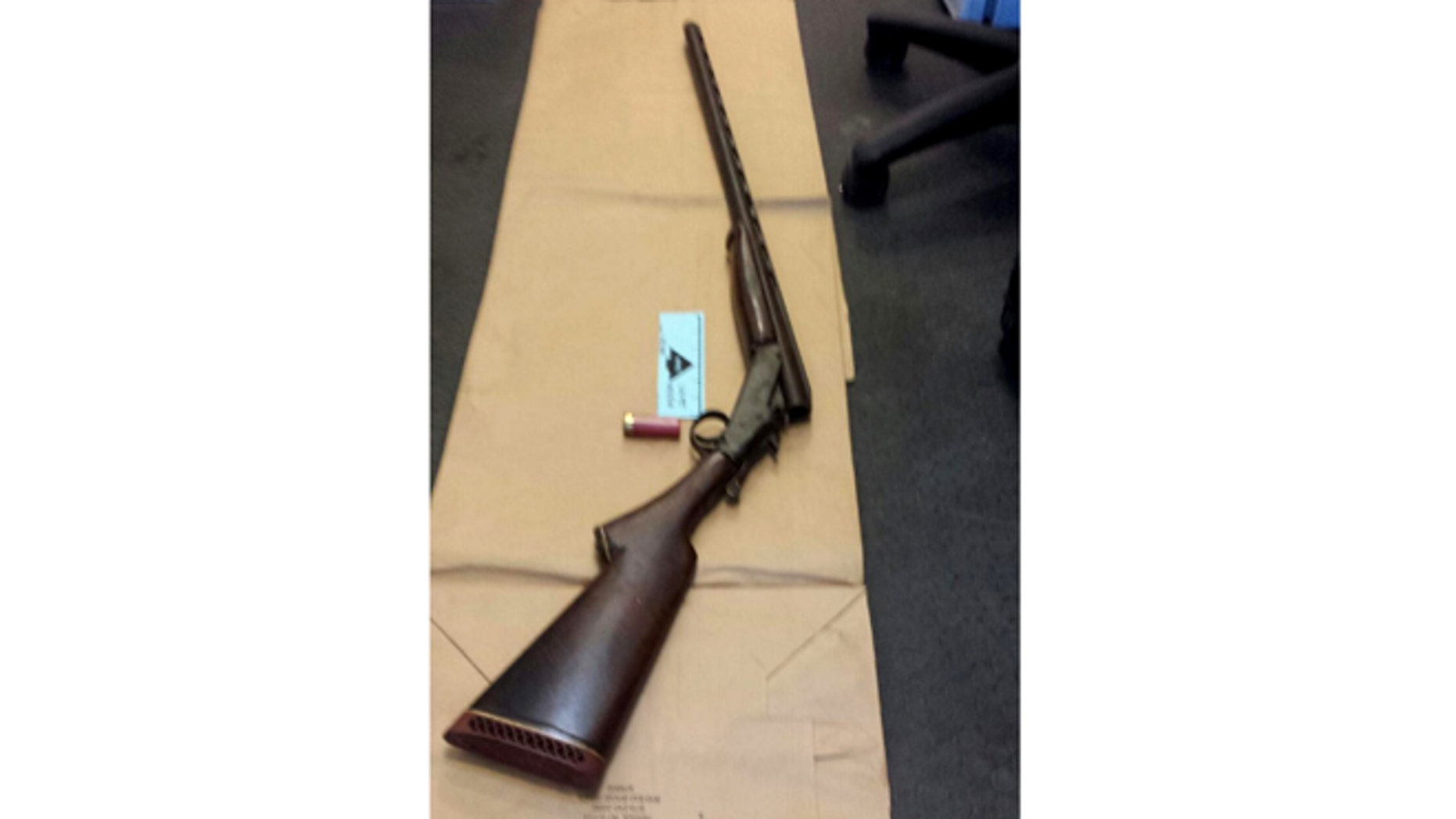 Apr. 12, 2014: This photo provided by the New York City Police Department shows a shotgun displayed on the floor of a police precinct in New York.