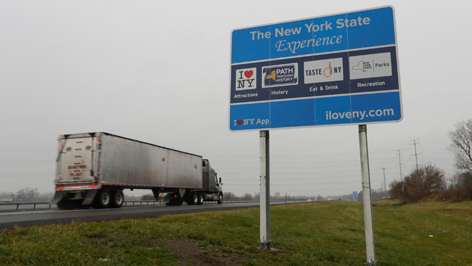 "Nov. 29, 2016: A truck passes a sign for ""I Love New York"" and other state attractions on the New York State Thruway in Utica, N.Y."