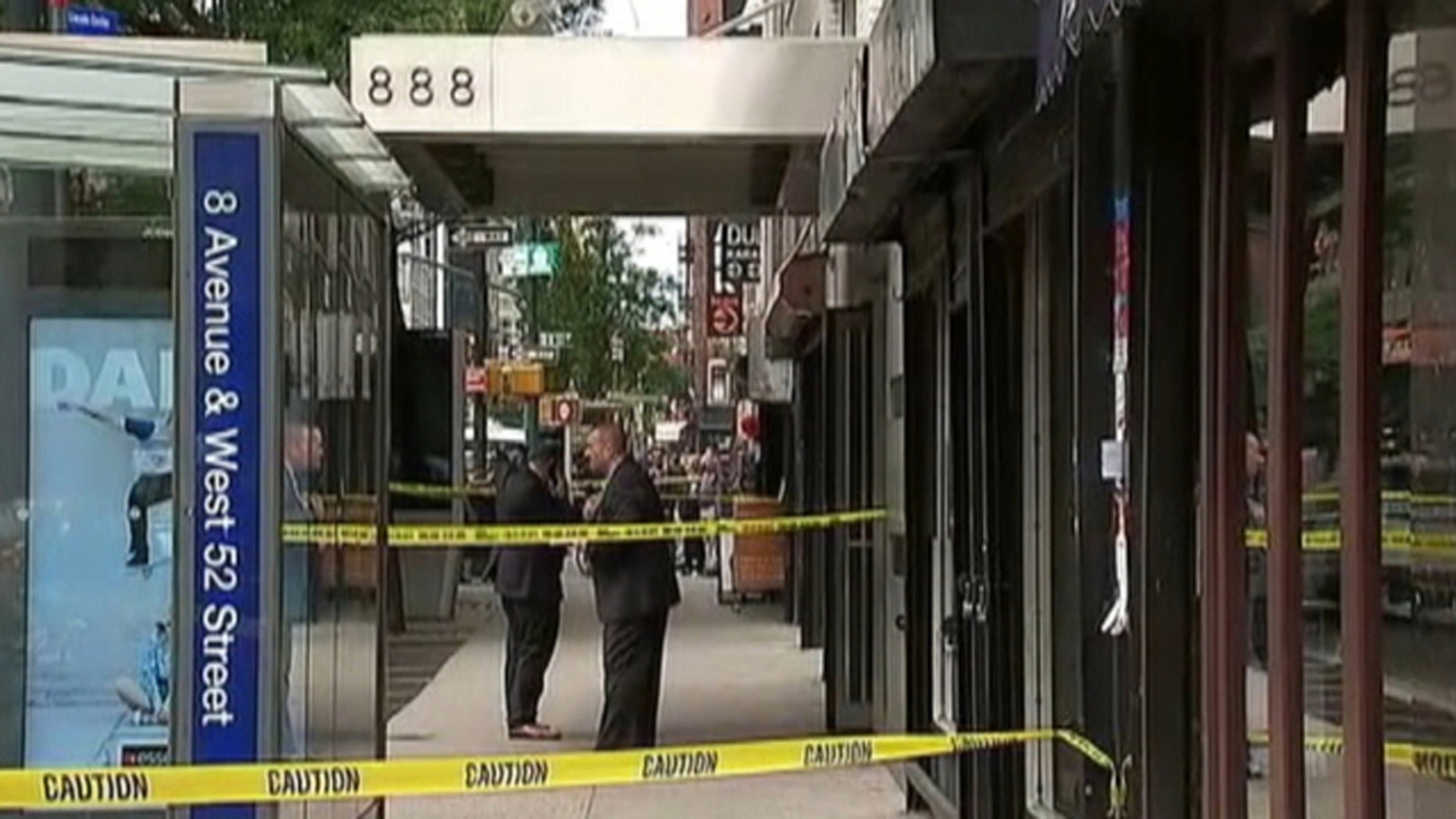Four teenagers were stabbed in New York City's Theater District during a fight among students outside a school, police said.