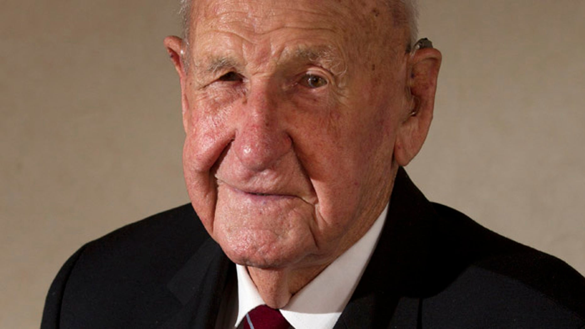 March 3: Veteran Les Munro poses for a photo at his home in Tauranga, New Zealand.