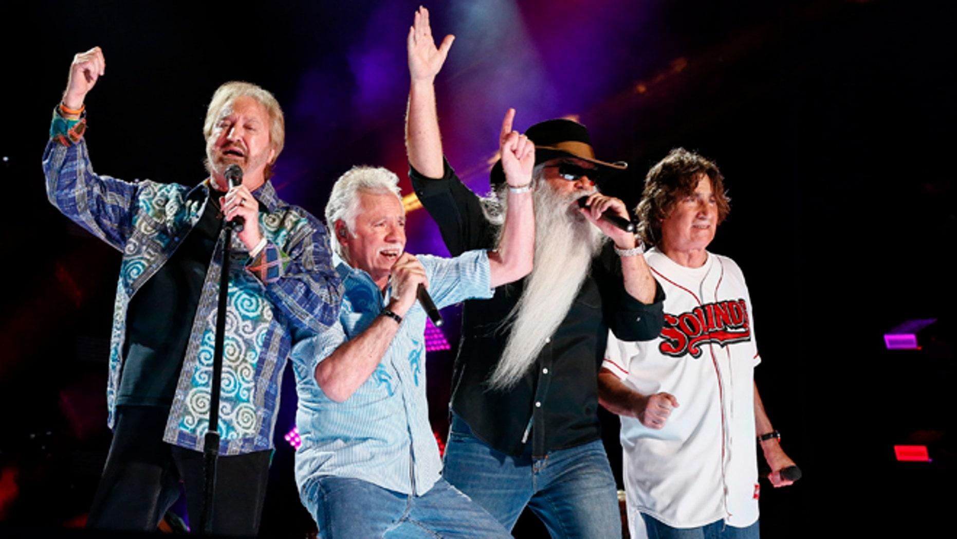 June 12, 2015. Duane Allen, from left, Joe Bonsall, William Lee Golden, and Richard Sterban of The Oak Ridge Boys perform at LP Field at the CMA Music Festival in Nashville, Tenn.
