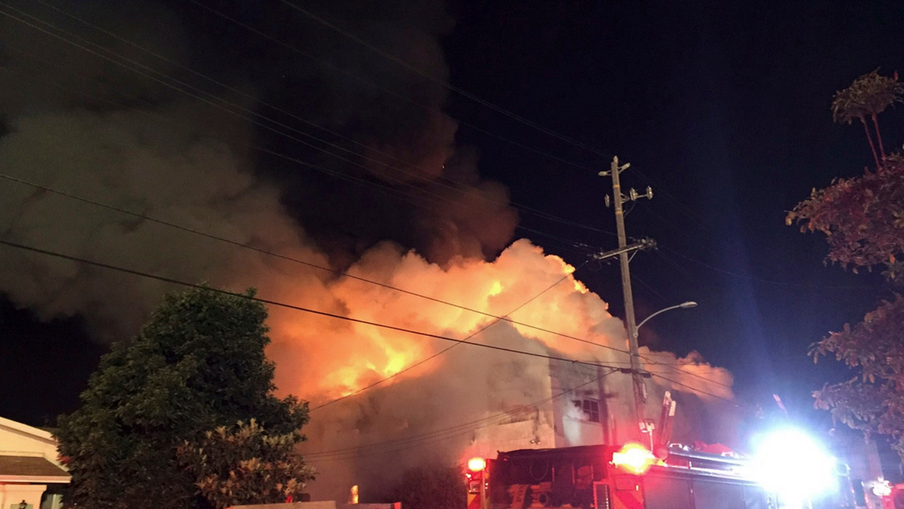 This photo provided by @seungylee14 shows the scene of a fire in Oakland, early Saturday, Dec. 3, 2016.