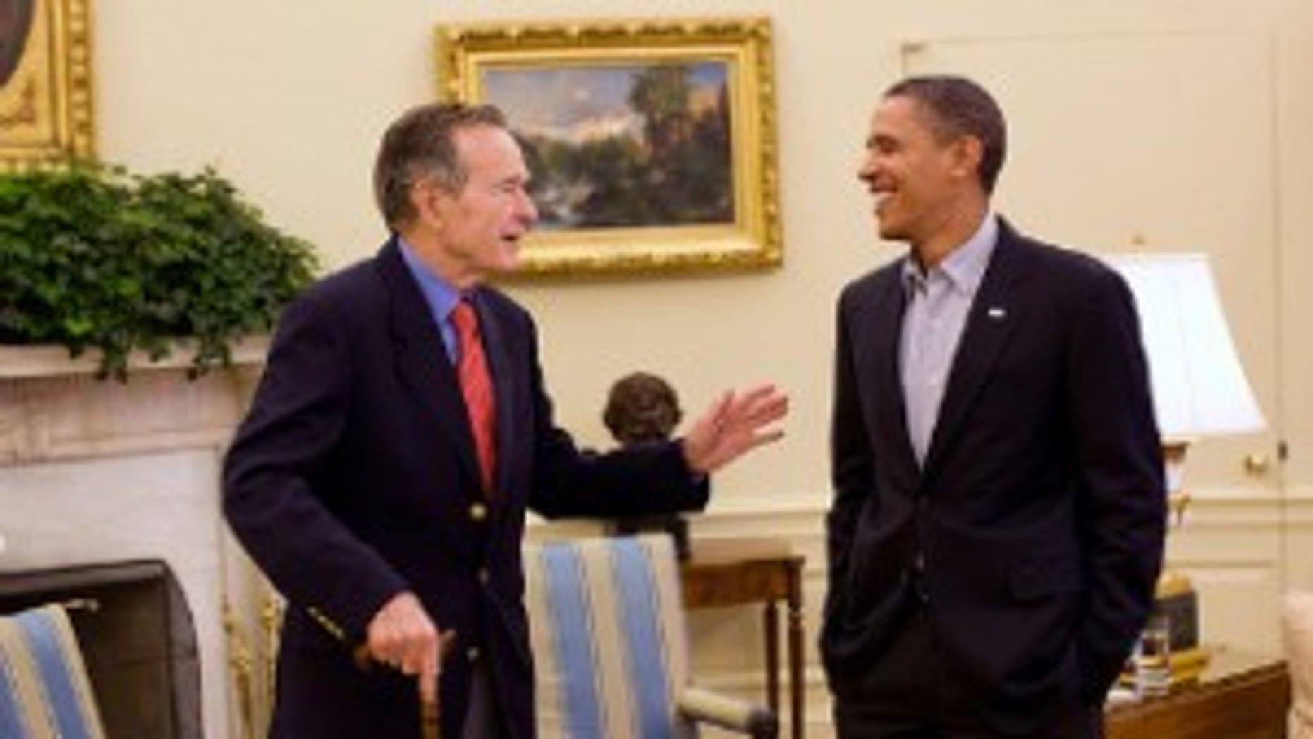 Former President George H.W. Bush makes a social call to President Obama.  White House Photo