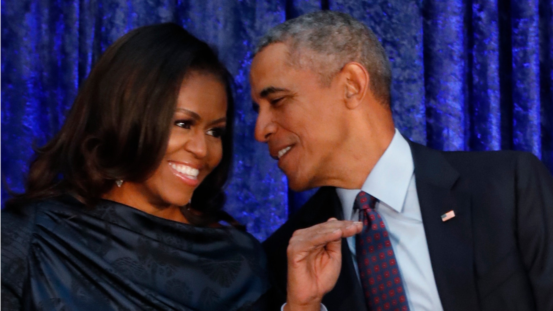 """Former first lady Michelle Obama got political during a chat at a women's leadership conference Thursday, likening her husband's presidency to having """"the good parent at home."""""""