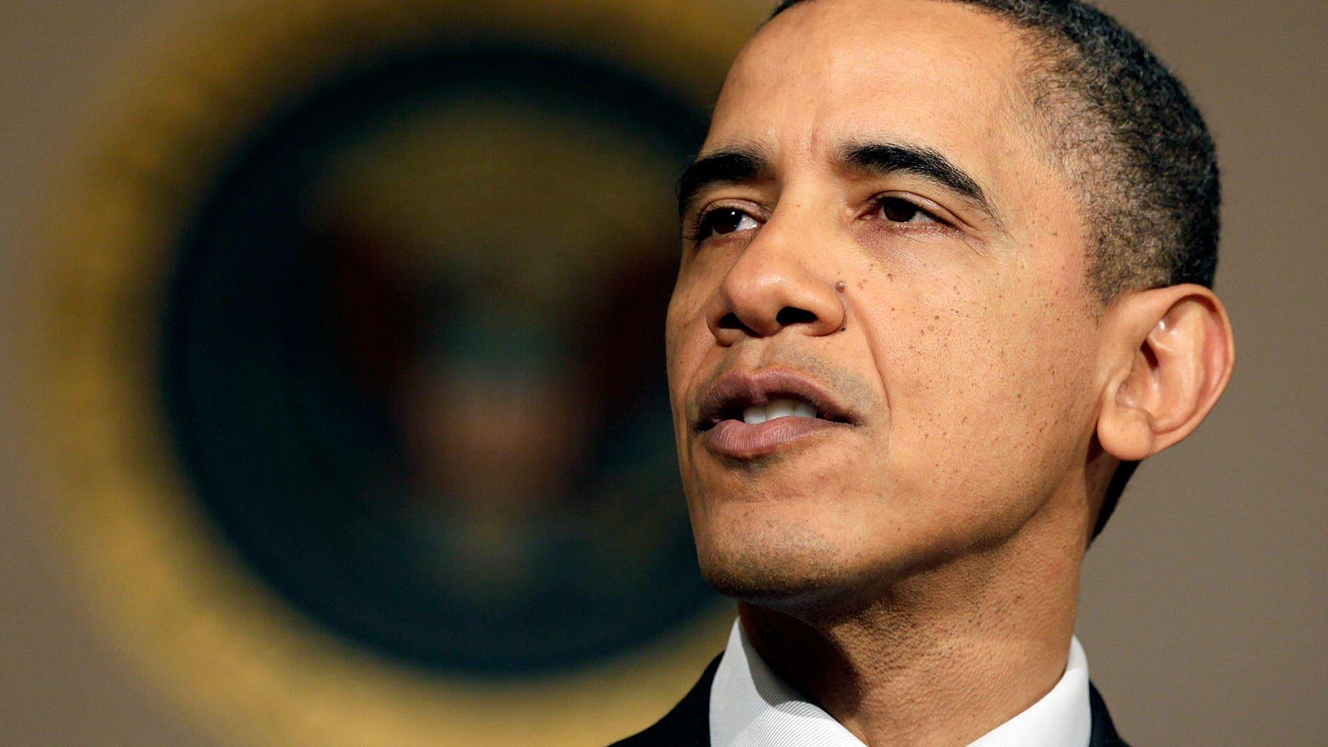 President Barack Obama makes a statement on the resignation of Egypt's President Hosni Mubarak in the Grand Foyer at the White House in Washington, Friday, Feb. 11, 2011. (AP)