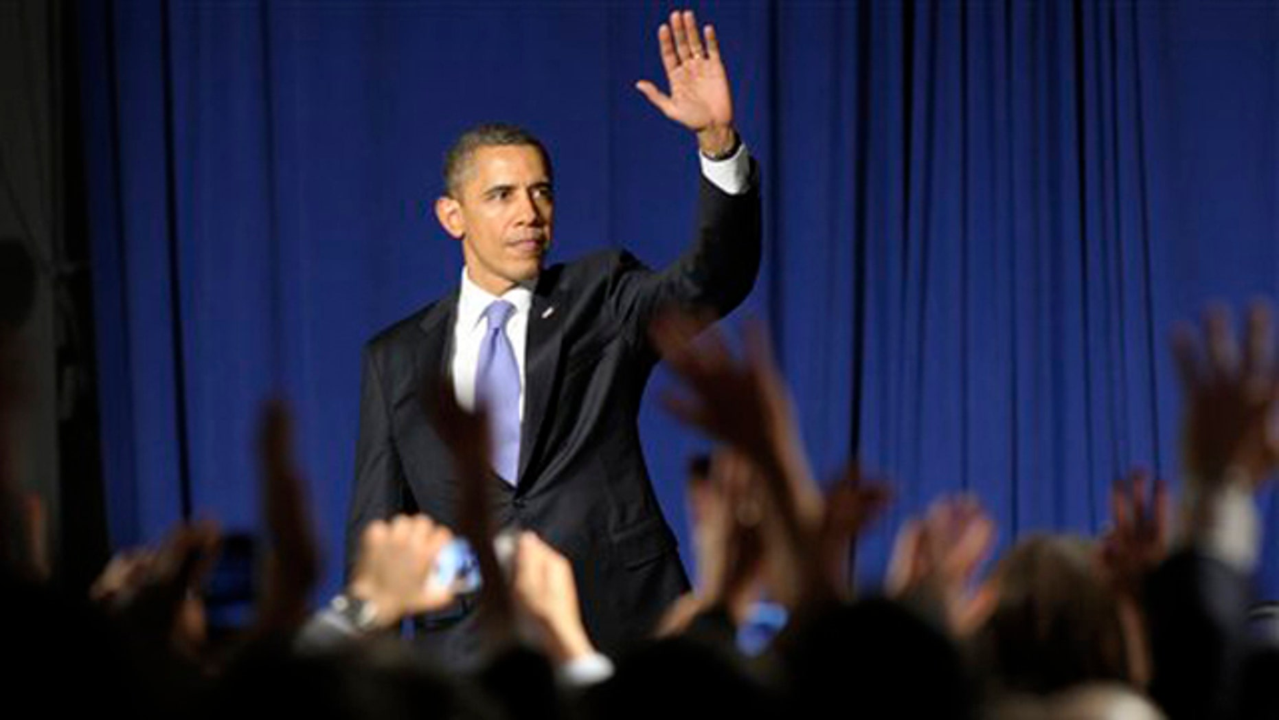 March 1, 2012: President Obama waves to the crowd after speaking at a fundraiser in New York City.