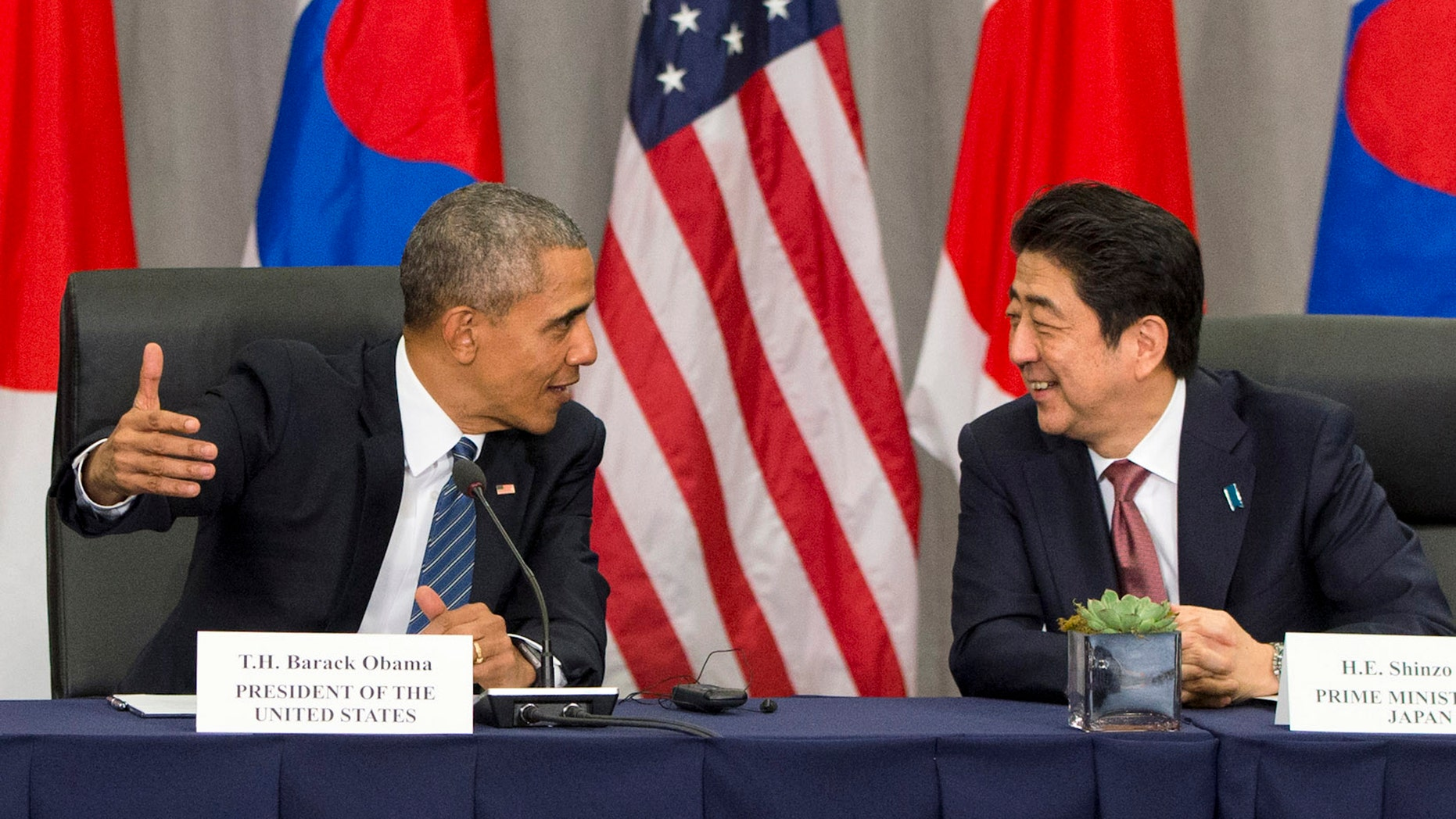 FILE - March 31, 2016: President Obama speaks with Japanese Prime Minister Shinzo Abe during their meeting at the Nuclear Security Summit in Washington. (AP Photo/Jacquelyn Martin)