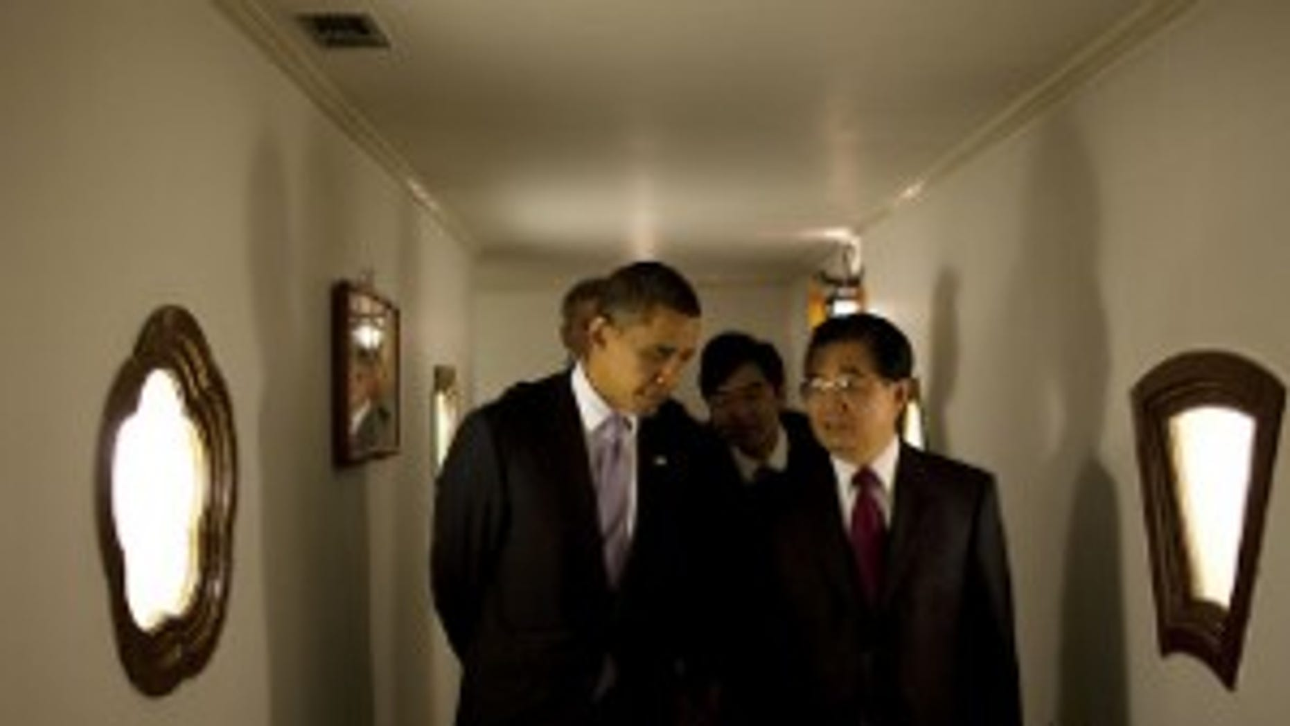 President Barack Obama walks with Chinese President Hu Jintao at Diaoyutai State Guest House in Beijing, China, Nov. 16, 2009. (Official White House Photo by Pete Souza)