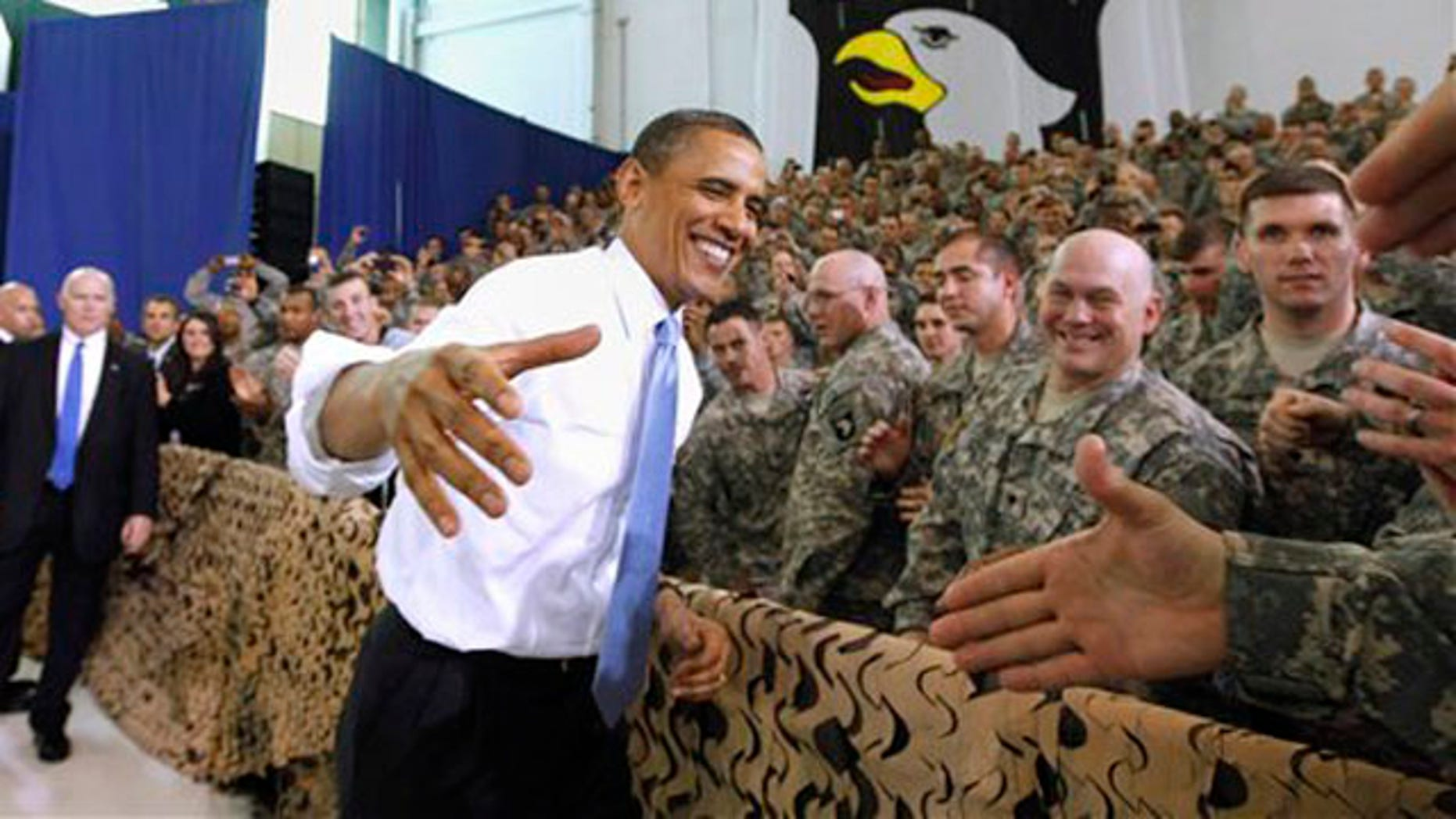 President Obama greets military personnel before addressing the troops.