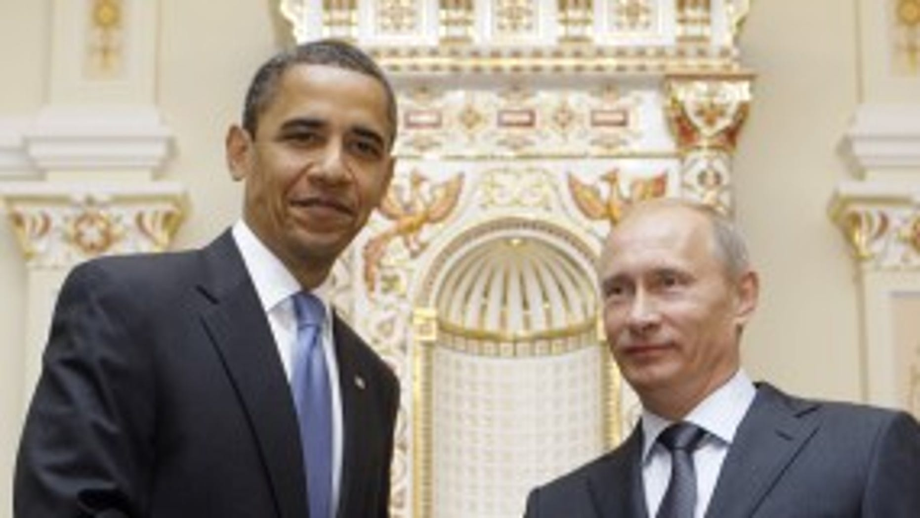 President Barack Obama, left,  shakes hands with Russian Prime Minister Vladimir Putin during a meeting at Novo Ogaryovo, Tuesday, July 7, 2009, in Moscow. (AP Photo/Haraz N. Ghanbari)