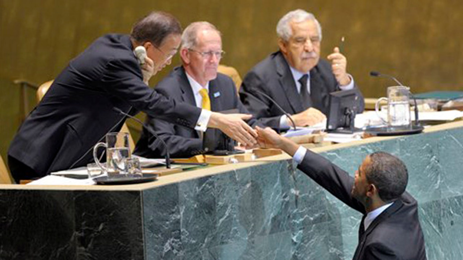 Sept.  22, 2010: President Barack Obama reaches to shake the hand of UN Secretary General Ban-Ki Moon, left, before he delivers remarks at the Millennium Development Goals Conference at the United Nations.