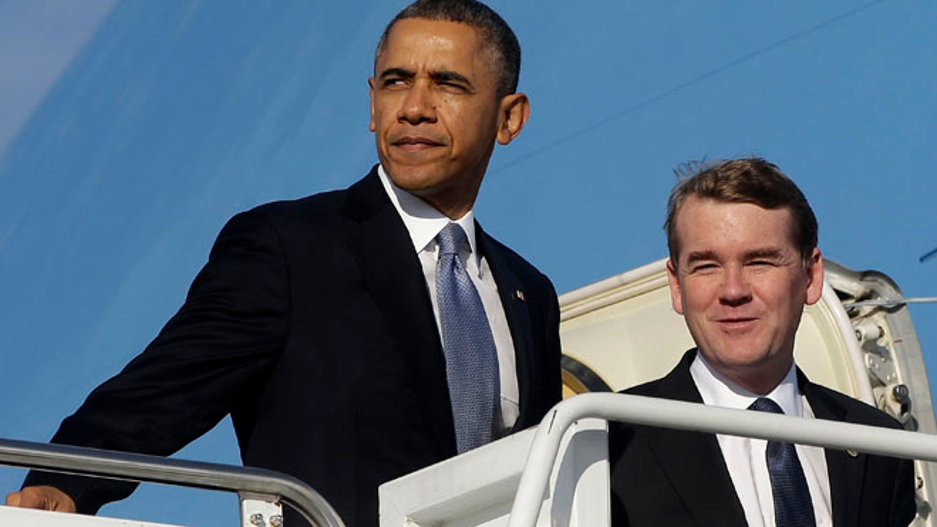 Nov. 6, 2013: President Barack Obama and Democratic Senatorial Campaign Committee Chairman Sen. Michael Bennett, D-Colo., board Air Force One at Andrews Air Force Base.