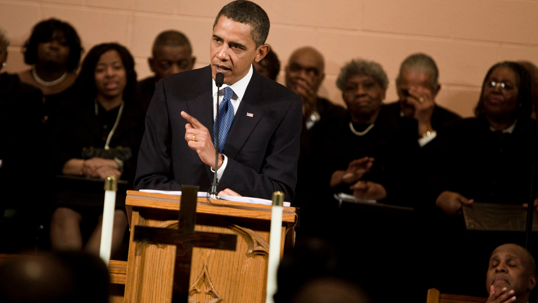 President Barack Obama speaks at Vermont Avenue Baptist Church January 17, 2010 in Washington, DC. (Photo by Brendan Smialowski/Getty Images)