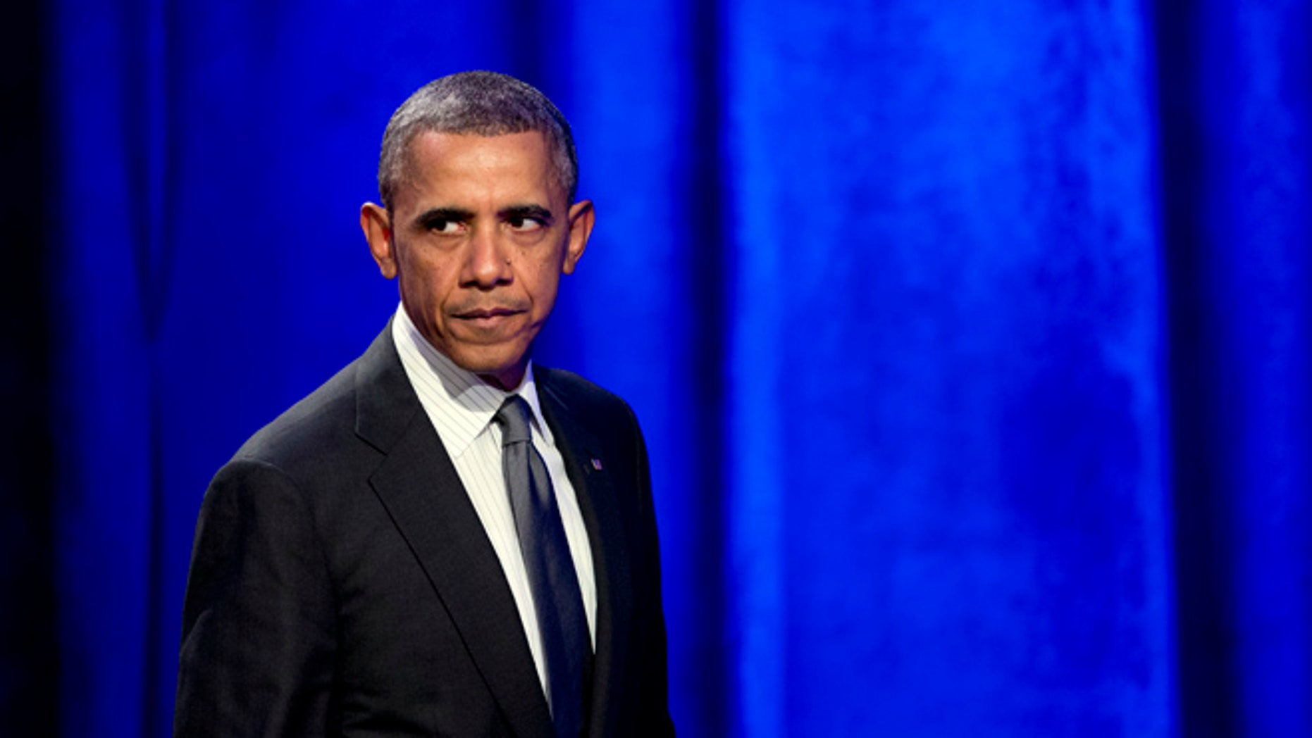 Feb. 25, 2014: President Obama glances at the crowd as walks off the stage after speaking at the National Organizing Summit in Washington.