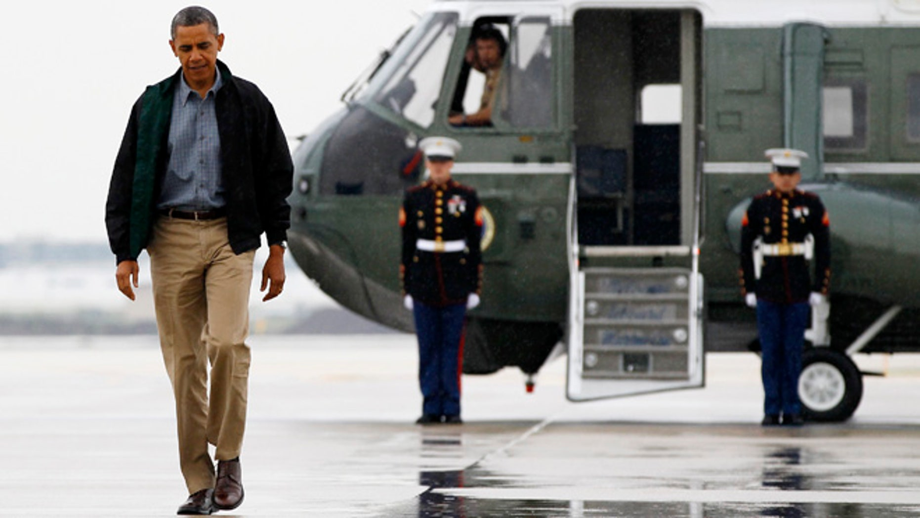President Barack Obama walks from Marine One to board Air Force One at O'Hare International Airport in Chicago, Monday, Aug. 13, 2012 en route to Offutt Air Force Base in Bellevue, Neb., and onto a three day campaign bus tour through Iowa.