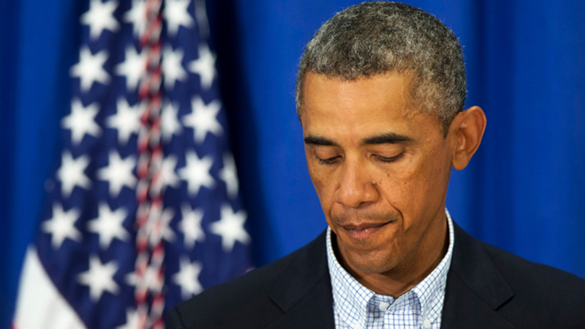Aug. 14, 2014: President Obama pauses as he speaks about the situations in Iraq and in Ferguson, Mo. in Edgartown, Mass., during his family vacation on the island of Martha's Vineyard.