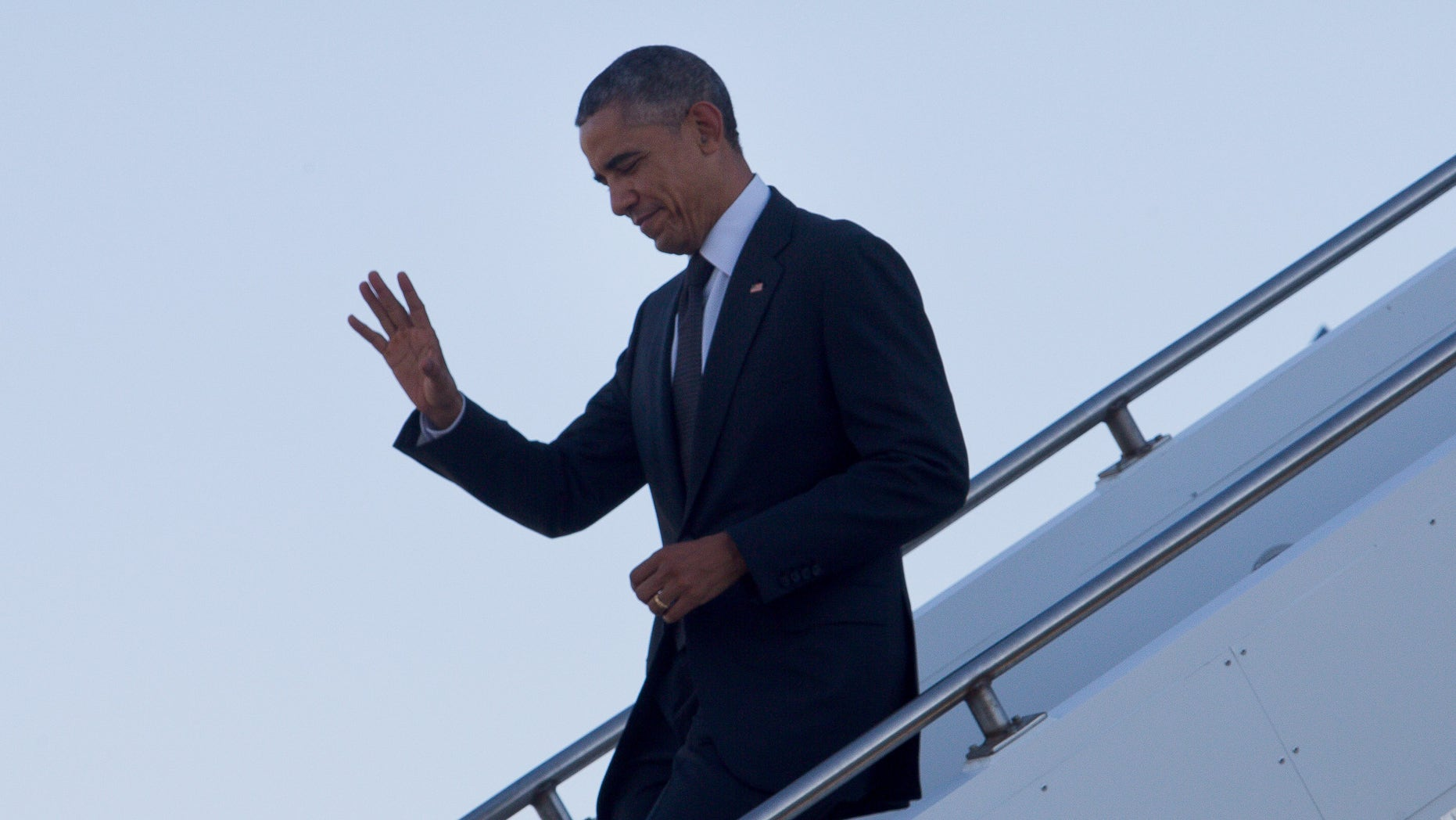 Nov. 15, 2014:  U.S. President Barack Obama waves as he arrives at Royal Australian Air Force Base Amberley near Brisbane, Australia