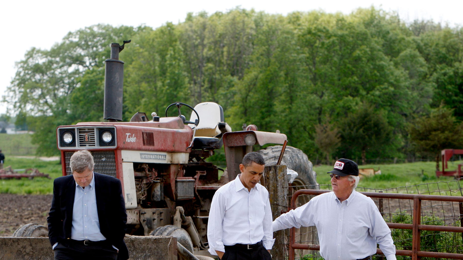In this April 28, 2010, file photo President Barack Obama, and Agriculture Secretary Tom Vilsack, left, tour a farm in Palmyra, Mo., with owner Lowell Schachtsiek, right.