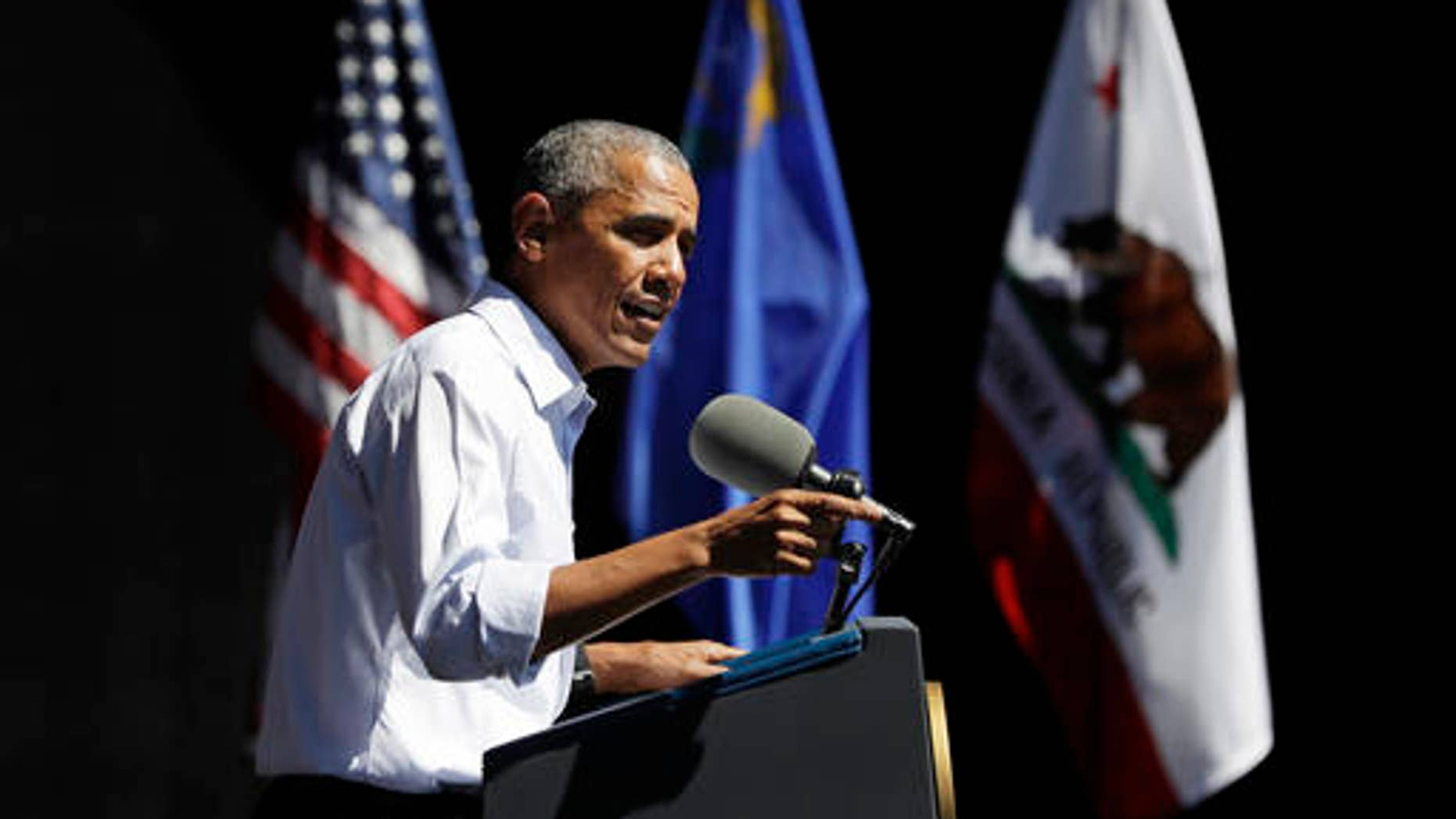 FILE--In this Aug. 31, 2016, President Barack Obama speaks during the 20th annual Lake Tahoe Summit at the Lake Tahoe Outdoor Arena at Harveys, in Stateline, Nev. Two weeks after President Obama made his first trip to Lake Tahoe with an impassioned plea about the inseparable link between the region's economy and its environment, Congress has taken a big step toward spending hundreds of millions of dollars to restore and protect the alpine lake over the next 10 years. (AP Photo/Carolyn Kaster, file)