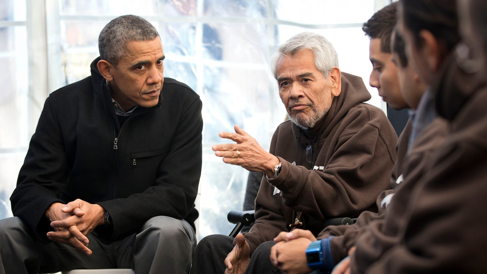 President Barack Obama, left, listens to Eliseo Medina, right, Secretary-Treasurer of Service Employees International Union (SEIU), as he meets with individuals who are taking part in Fast for Families on the National Mall in Washington, Friday, Nov. 29, 2013. Obama met with the group who are fasting on behalf of immigration reform. (AP Photo/Pablo Martinez Monsivais)