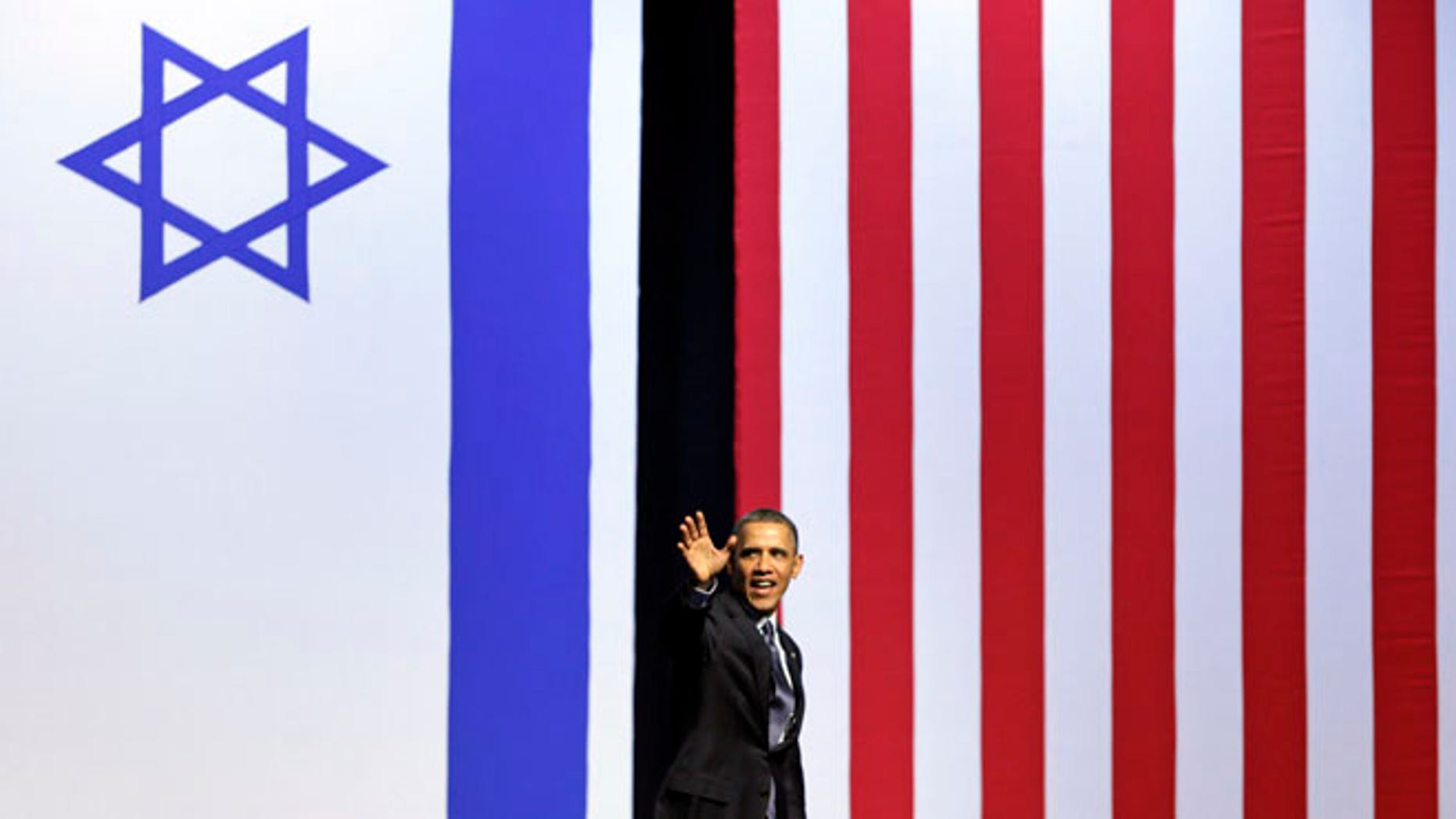 March 21, 2013: President Barack Obama waves as he leaves the stage after speaking at the International Convention Center in Jerusalem.