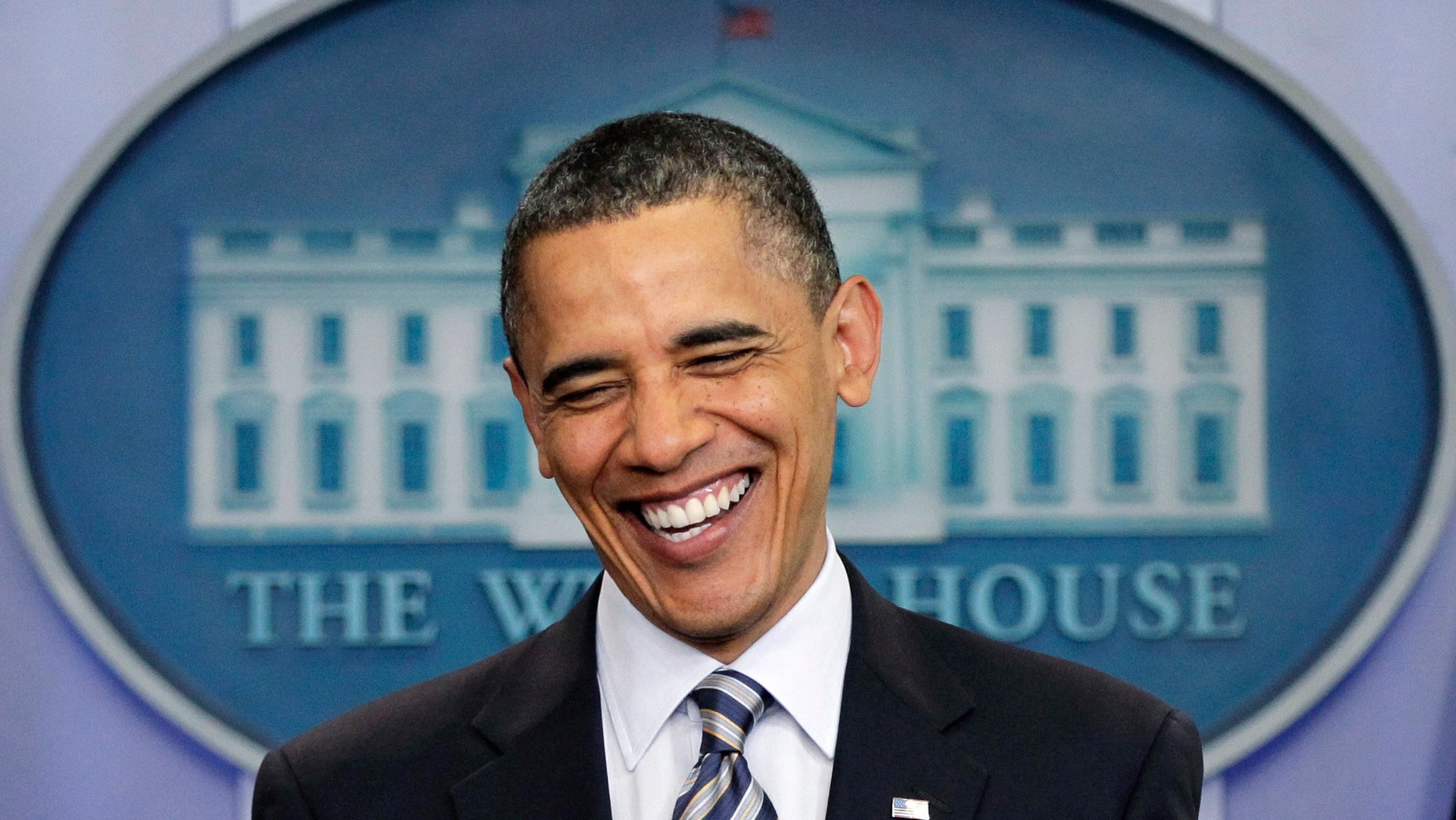 In this April 27, 2011, file photo President Obama laughs as comments to reporters on the controversy over his birth certificate and true nationality in the White House briefing room in Washington. (AP)
