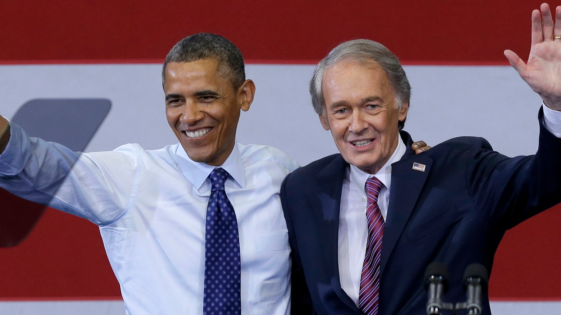 President Barack Obama and Massachusetts Democratic Senate candidate Rep. Ed Markey wave during a campaign rally. Markey is hoping to beat GOP challenger Gabriel Gomez in the special election on June 25.