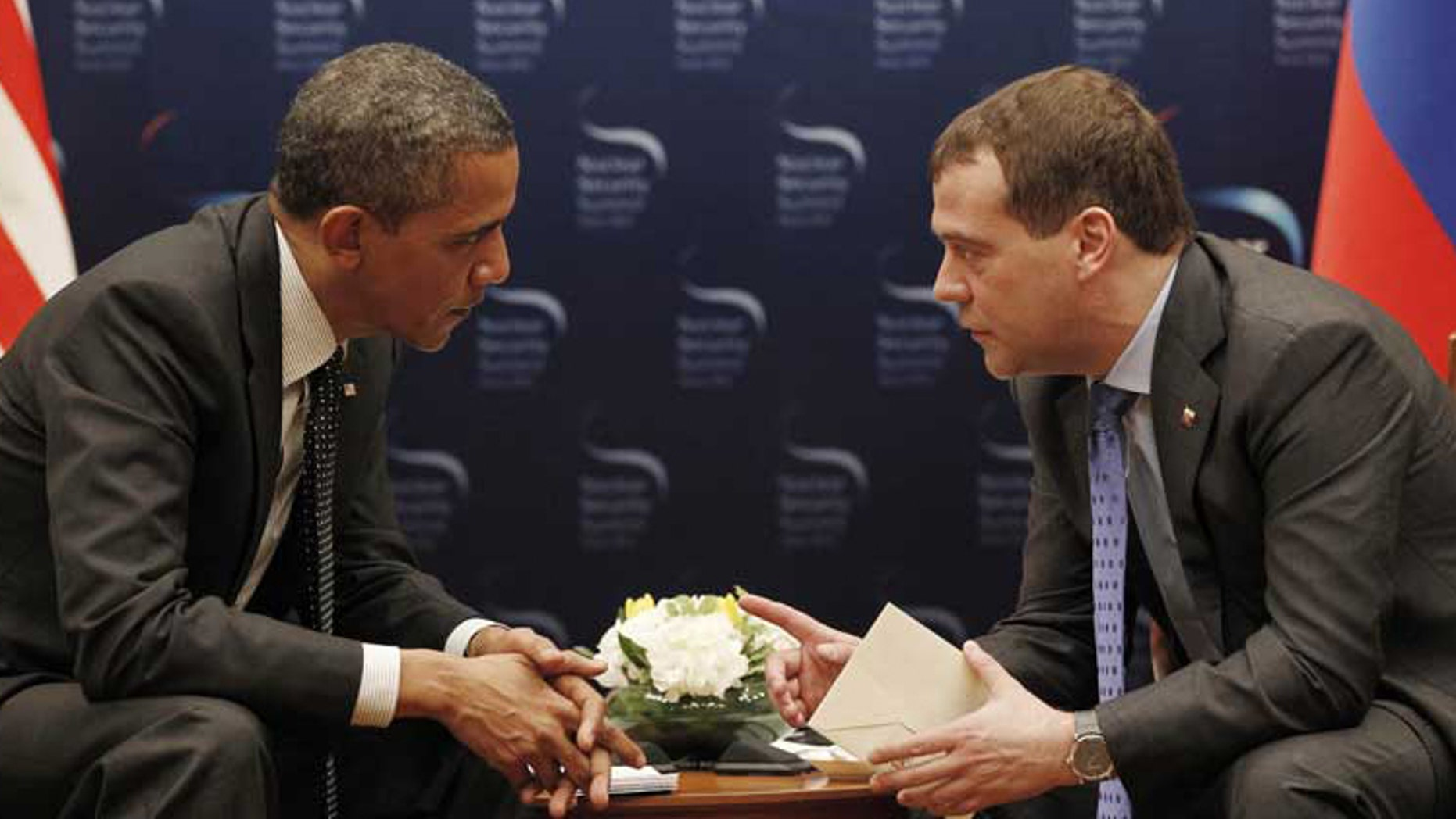 When President Obama met with Russian President Dmitry Medvedev in Seoul on March, 26, a live microphone picked up an indiscreet aside from Obama. (AP Photo/Pablo Martinez Monsivais)