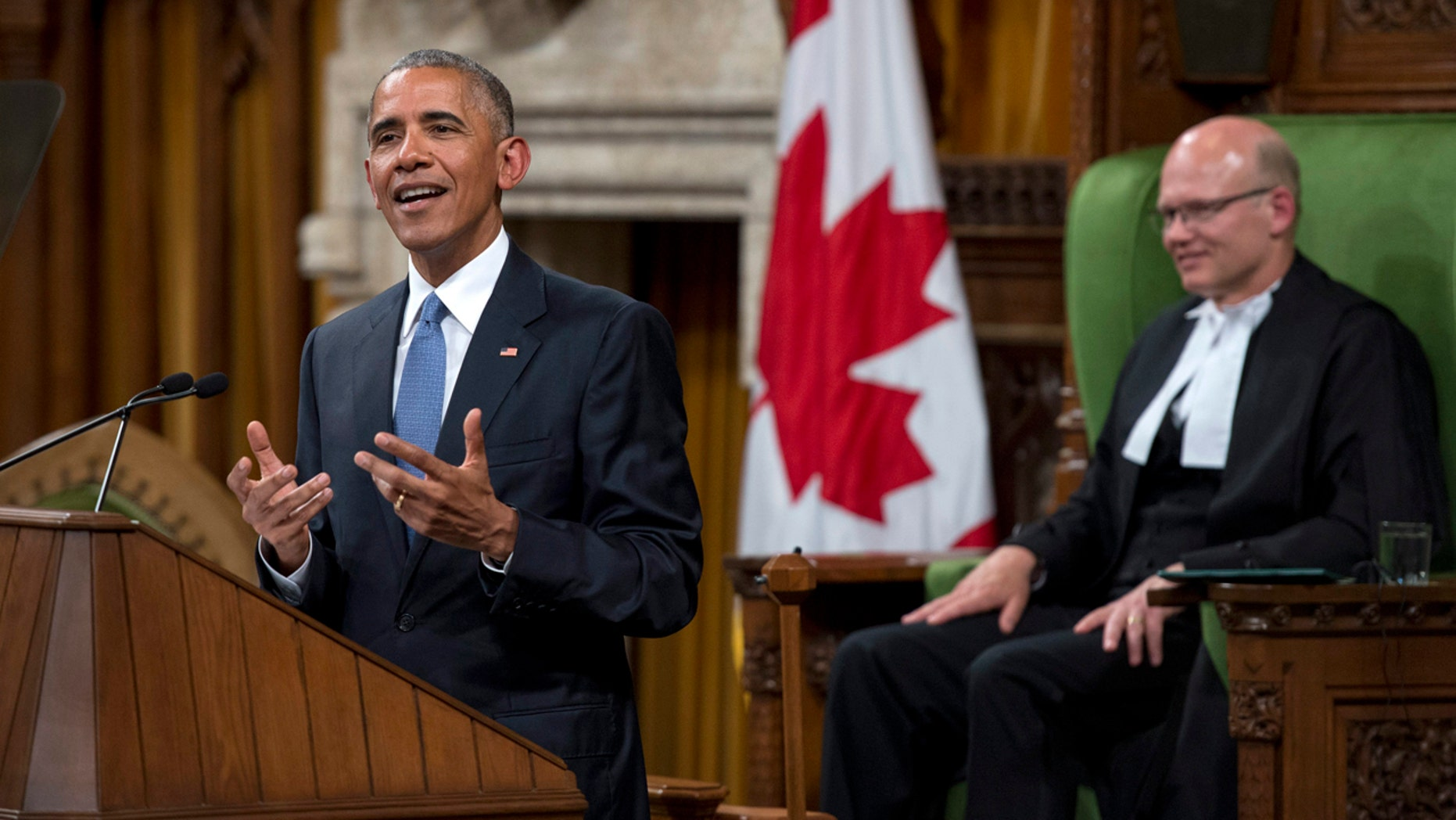 June 29, 2016: U.S. President Barack Obama addresses the Canadian Parliament in the House of Commons in Ottawa, as House Speaker Geoff Regan looks on.