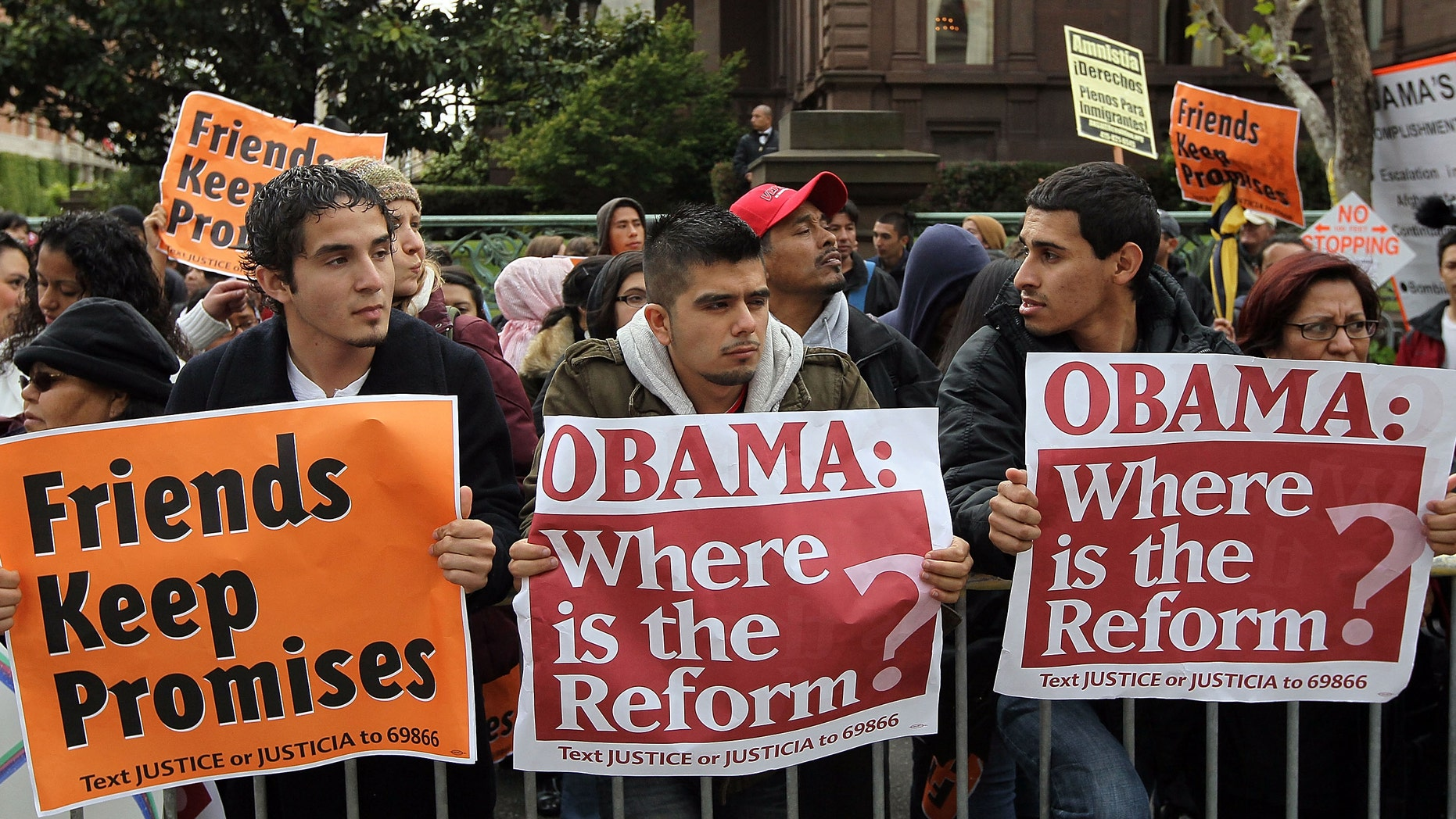 SAN FRANCISCO - MAY 25:  A group carries signs asking for immigration reform as they protest outside of the Fairmont Hotel before U.S. President Barack Obama arrives for a fundraiser May 25, 2010 in San Francisco, California. Hundreds of protestors from different political groups staged the demonstration at a campaign fundraiser for U.S. Sen. Barbara Boxer (D-CA).  (Photo by Justin Sullivan/Getty Images)