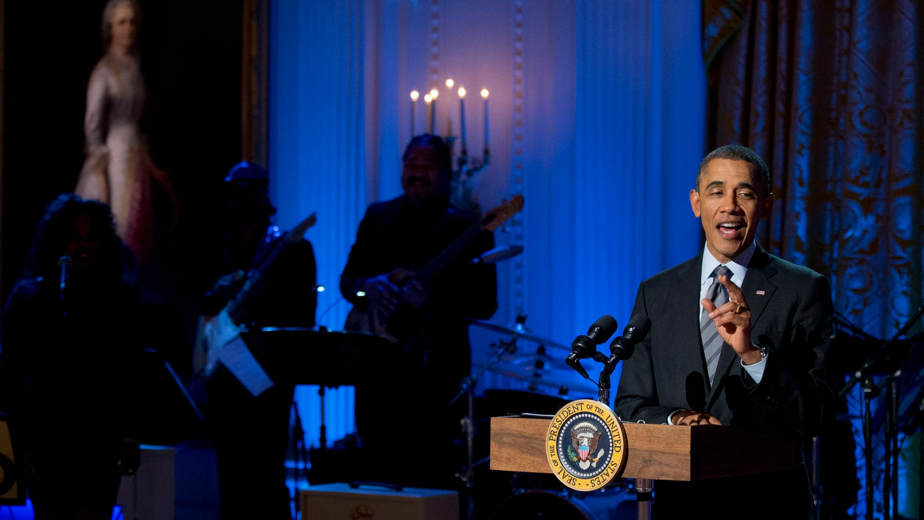 """March 6, 2014: President Obama speaks during the """"Women of Soul,"""" in the East Room of the White House in Washington."""