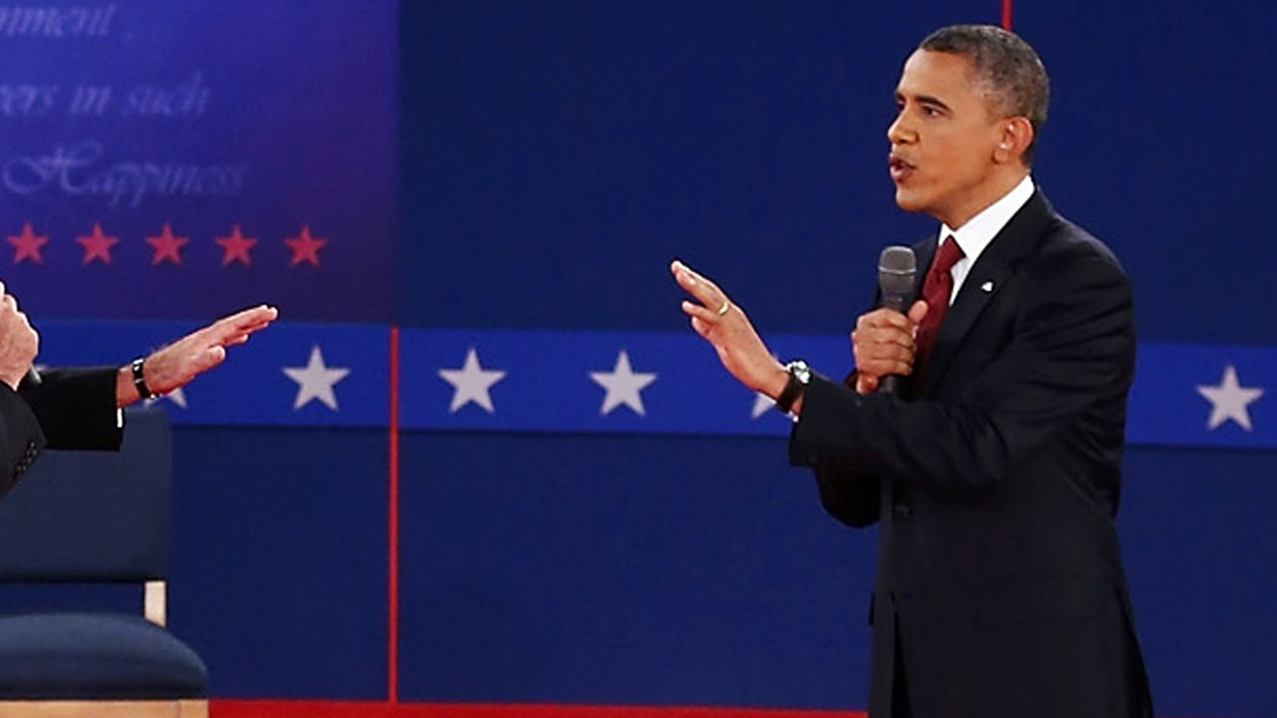 FiOCTOBER 16:  Republican presidential candidate Mitt Romney (L) and U.S. President Barack Obama talk to each other during a town hall style debate at Hofstra University October 16, 2012 in Hempstead, New York. During the second of three presidential debates, the candidates fielded questions from audience members on a wide variety of issues.  (Photo by Bruce Bennett/Getty Images)