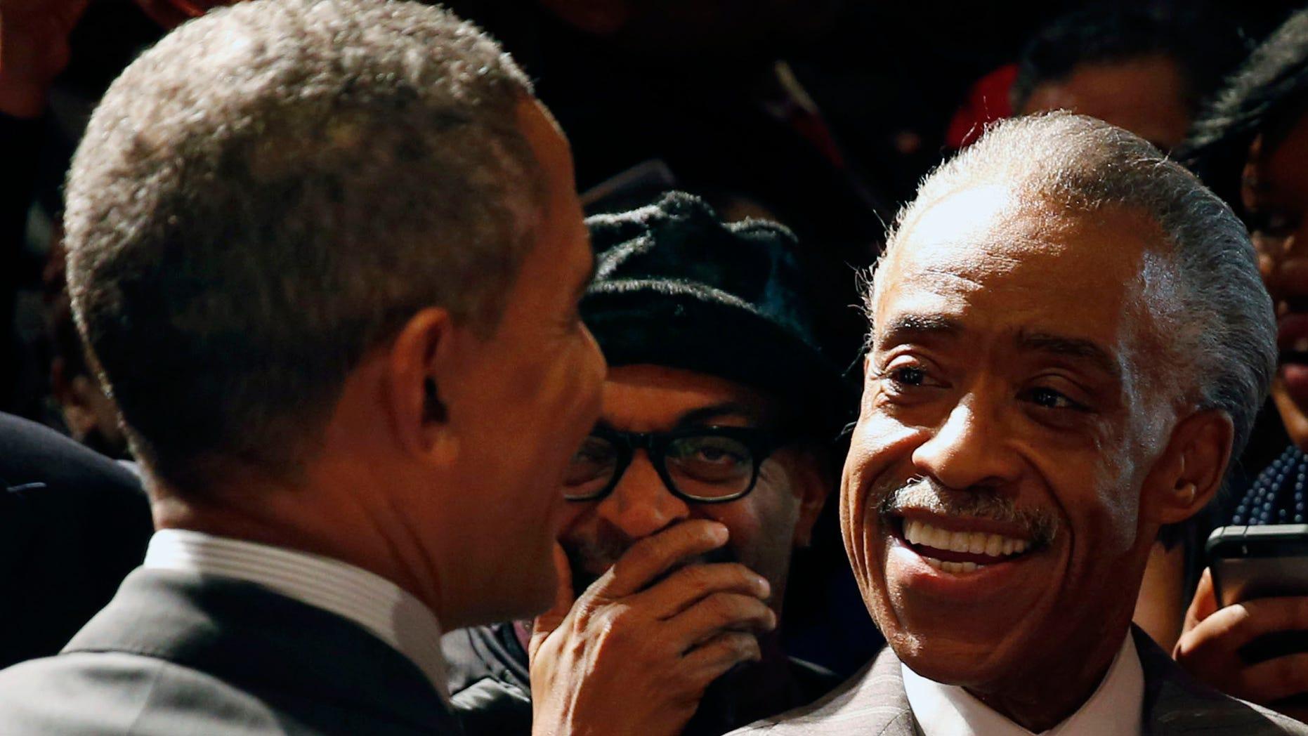 April 11, 2014: U.S. President Obama laughs with film director Spike Lee (C) and Reverend Al Sharpton (R).