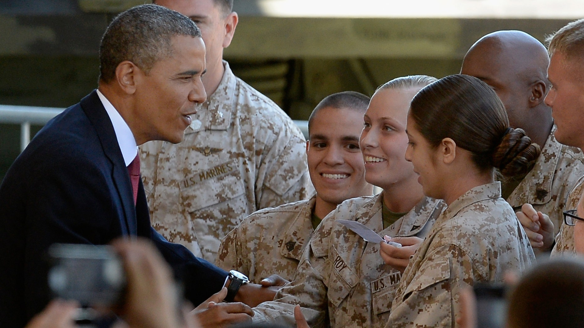 CAMP PENDLETON, CA - AUGUST 07:  U.S. President Barack Obama greets Marines after speaking at Camp Pendleton Marine Corps base visiting troops and their families to thank them for their service on August 7, 2013 in Camp Pendleton, California. Obama announced today that he canceled a planned meeting with Russian President Vladimir Putin in Moscow amid tensions over National Security Agency leaker Edward Snowden and other issues.  (Photo by Kevork Djansezian/Getty Images)