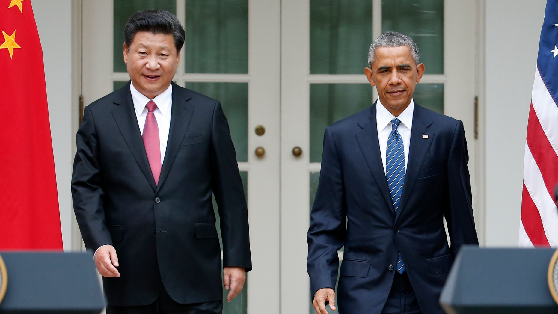 President Barack Obama and Chinese President Xi Jinping arrive for their joint new conference, Friday, Sept. 25,2015, in the Rose Garden of the White House in Washington. (AP Photo/Evan Vucci)