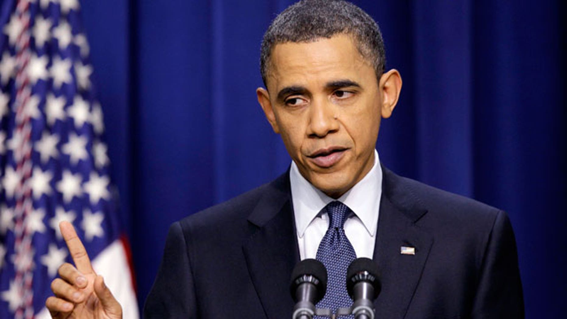 President Obama answers a question during a press conference on the White House complex in Washington, Friday, March 11, 2011. (AP)
