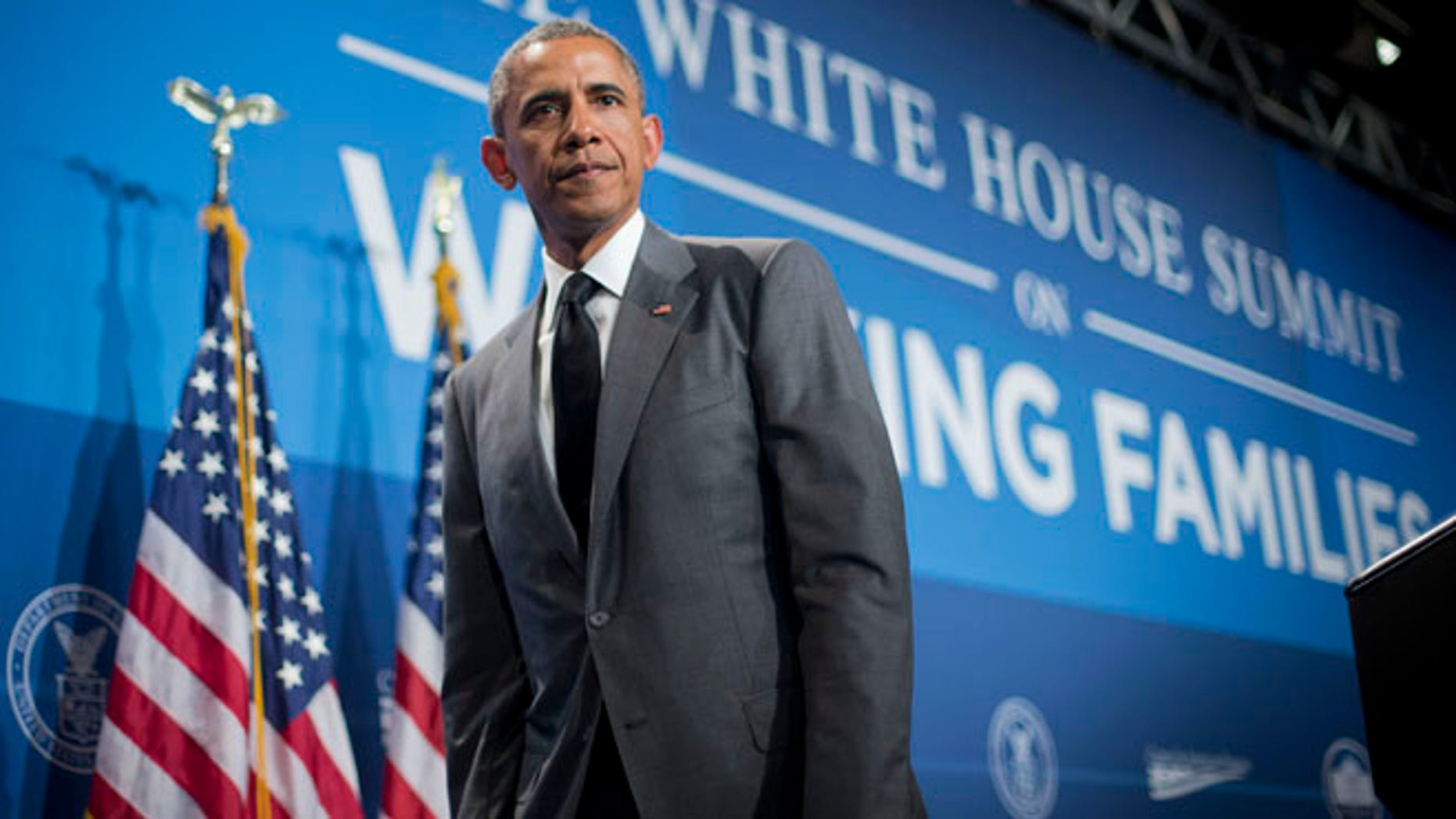 June 23, 2014: President Obama walks off stage after speaking at the White House Summit on Working Families in Washington.