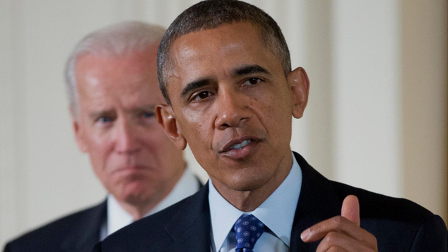 Jan. 22, 2014: Vice President Joe Biden listens as President Barack Obama speaks in the East Room of the White House in Washington.