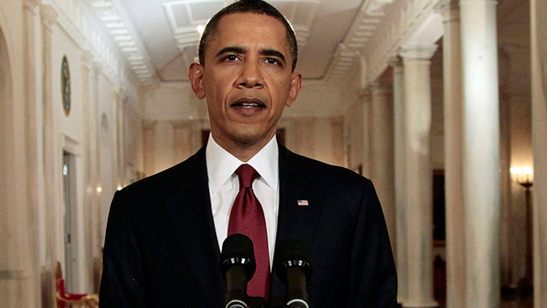 May 1: President Barack Obama reads his statement to photographers after making a televised statement on the death of Osama bin Laden from the East Room of the White House