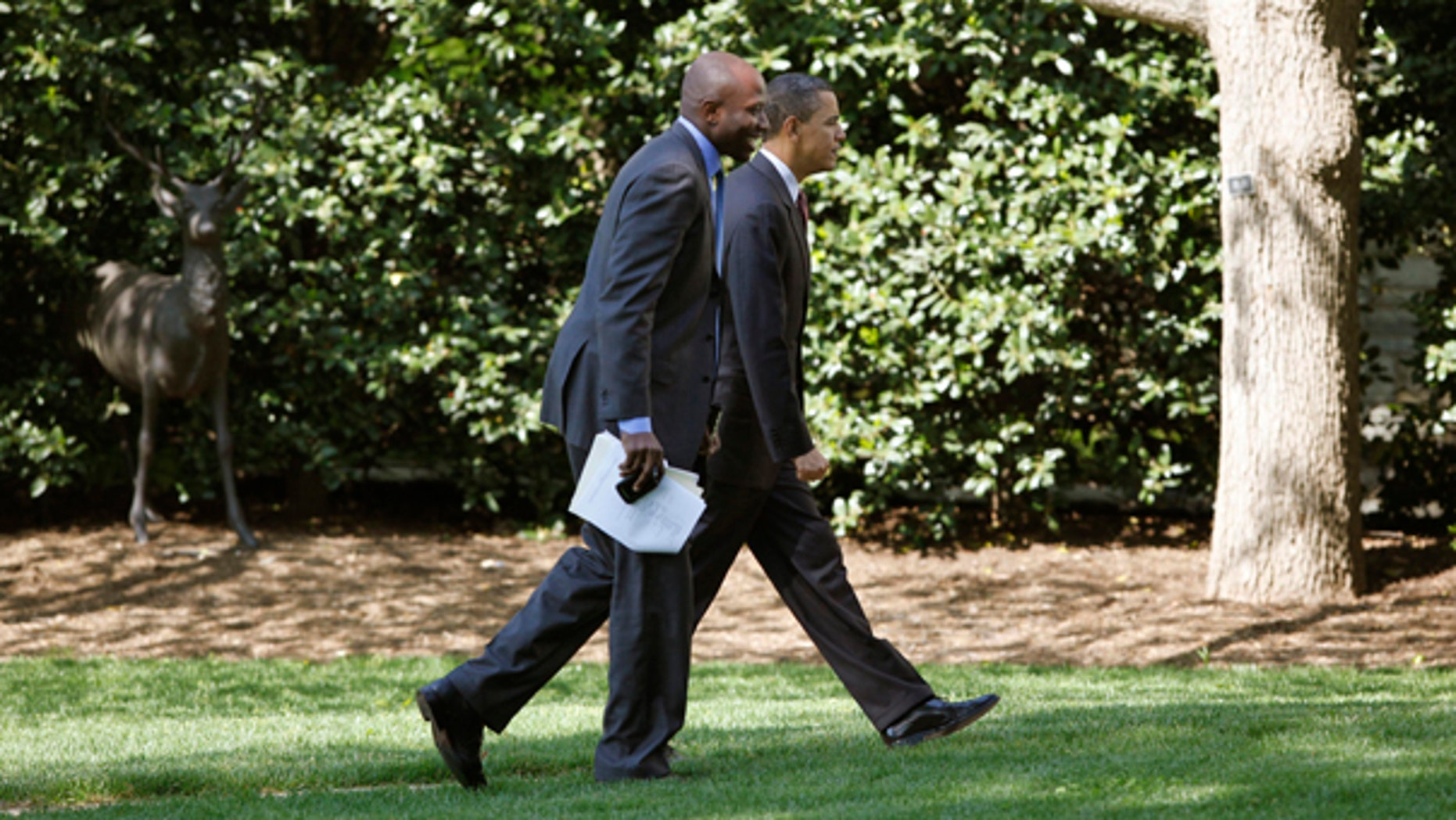 President Obama walks with aide Reggie Love, to the Oval Office of the White House in Washington, Friday, April 16, 2010. (AP)