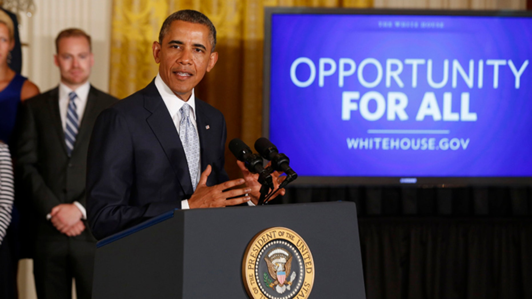June 9, 2014: President Obama speaks before he signs a presidential memorandum on reducing the burden of student loan debt in the East Room of the White House.