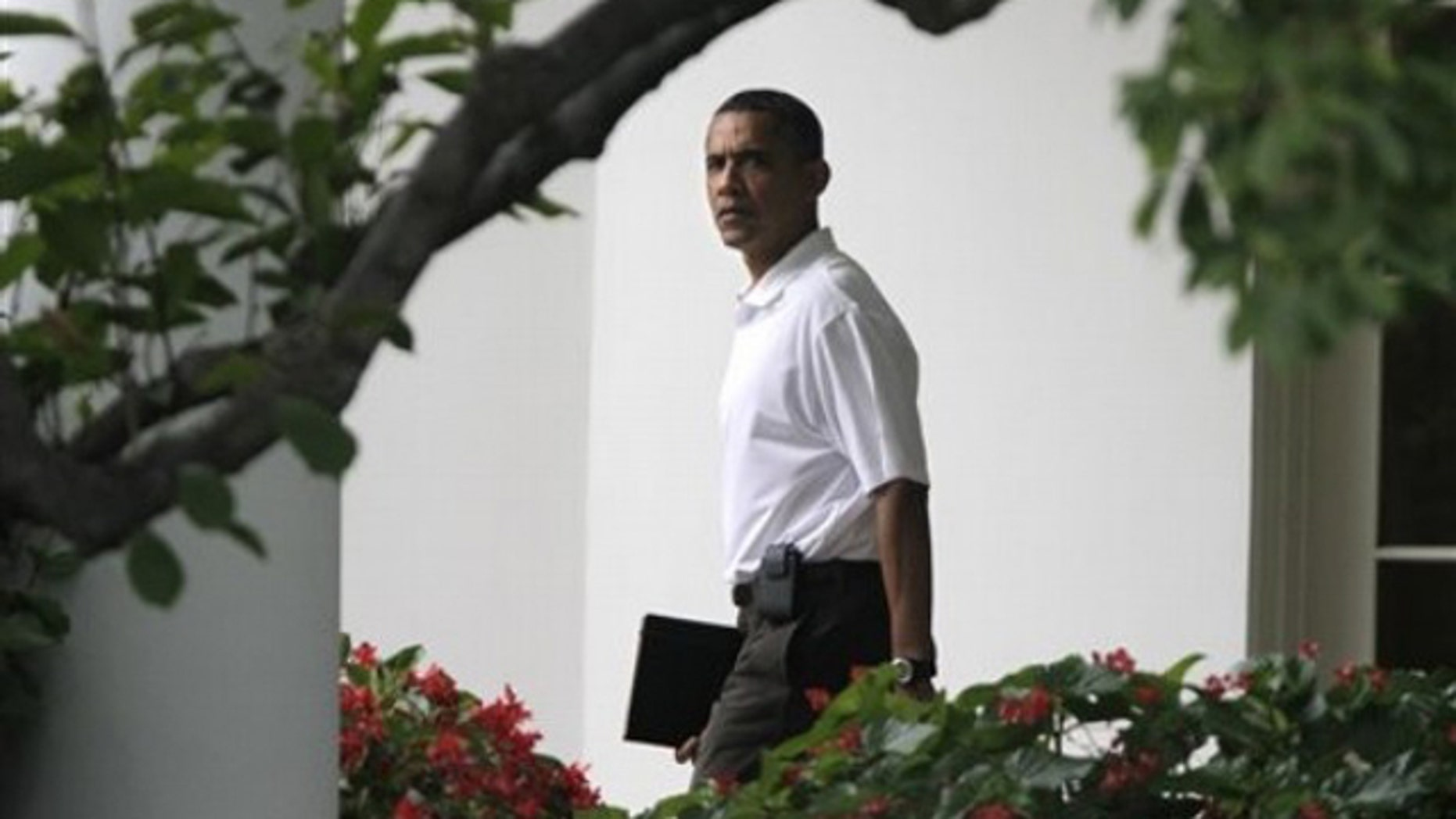 Saturday: President Obama leaves the Oval Office of the White House on his way to play golf at Andrews Air Force Base.
