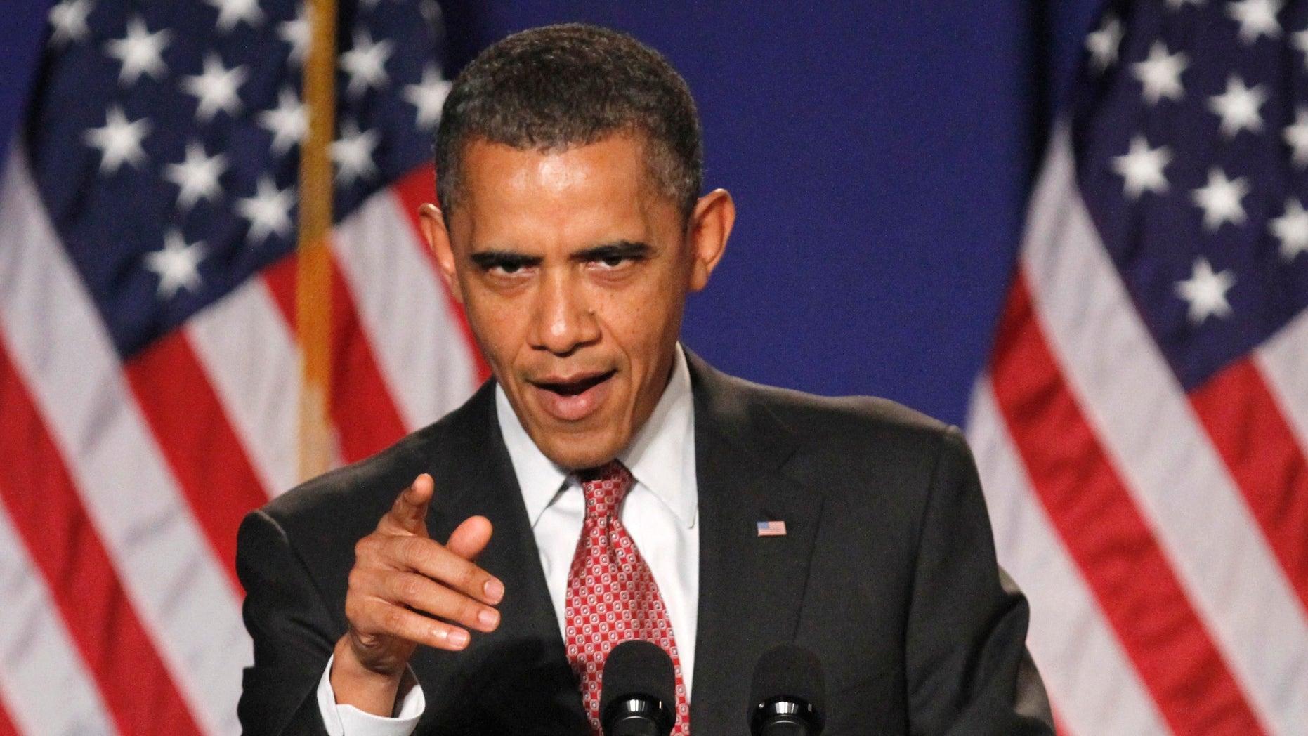 In this photo taken Friday, Sept. 16, 2011, President Barack Obama gestures while speaking in Alexandria, Va.