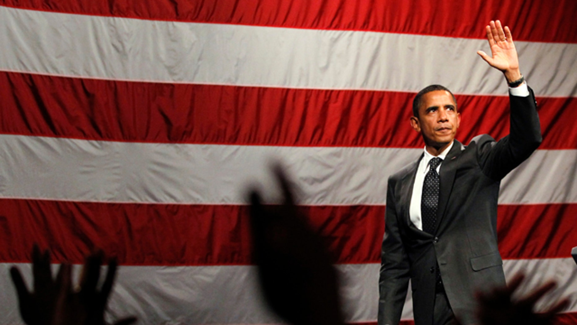 Sept. 26: President Barack Obama waves after a Democratic fundraiser at the House of Blues in West Hollywood, Calif.