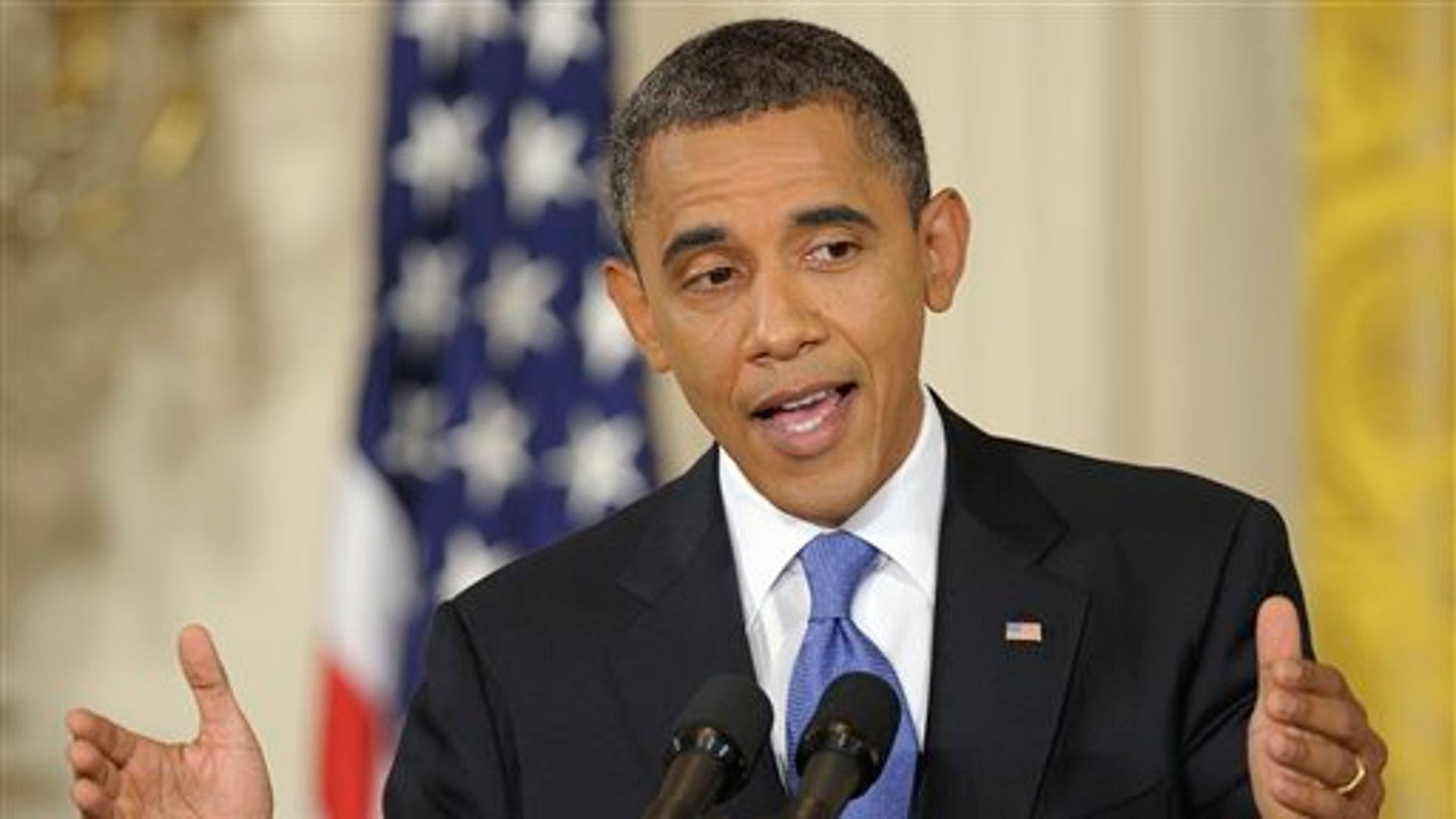 Oct. 6: President Barack Obama gestures during a news conference in the East Room of the White House in Washington.