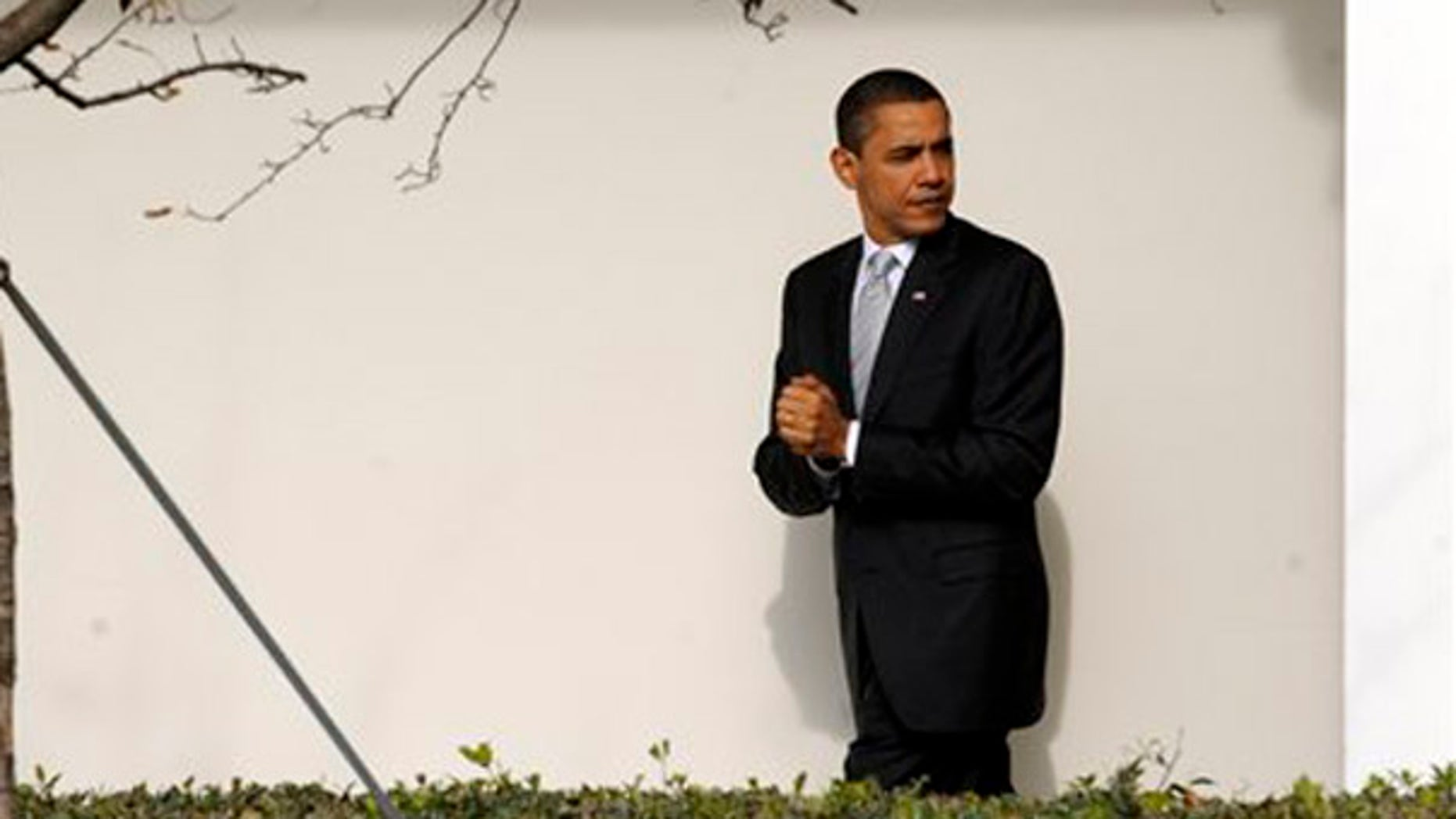 President Barack Obama walks along the Colonnade at the White House in Washington, Tuesday, Dec. 15, 2009. (AP)