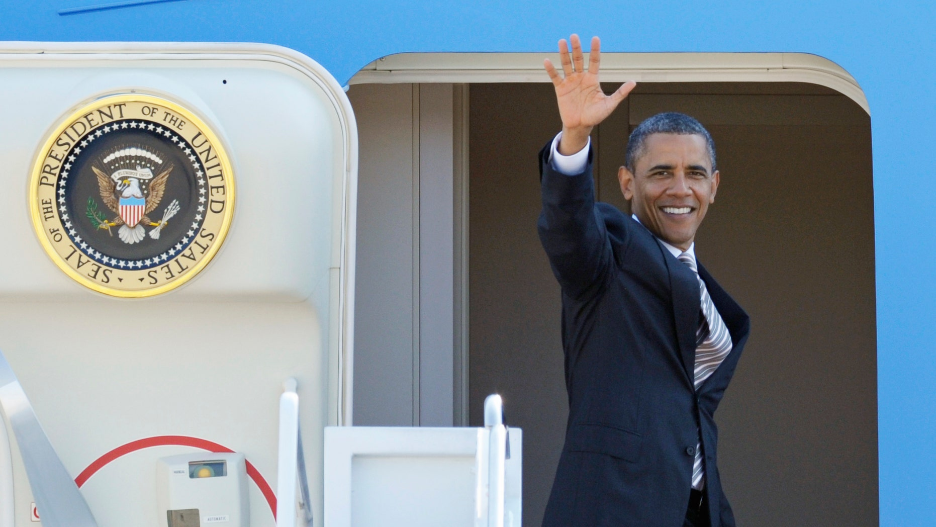 President Obama waves as he boards Air Force One at Andrews Air Force Base, Md., Wednesday, Sept. 14, 2011.