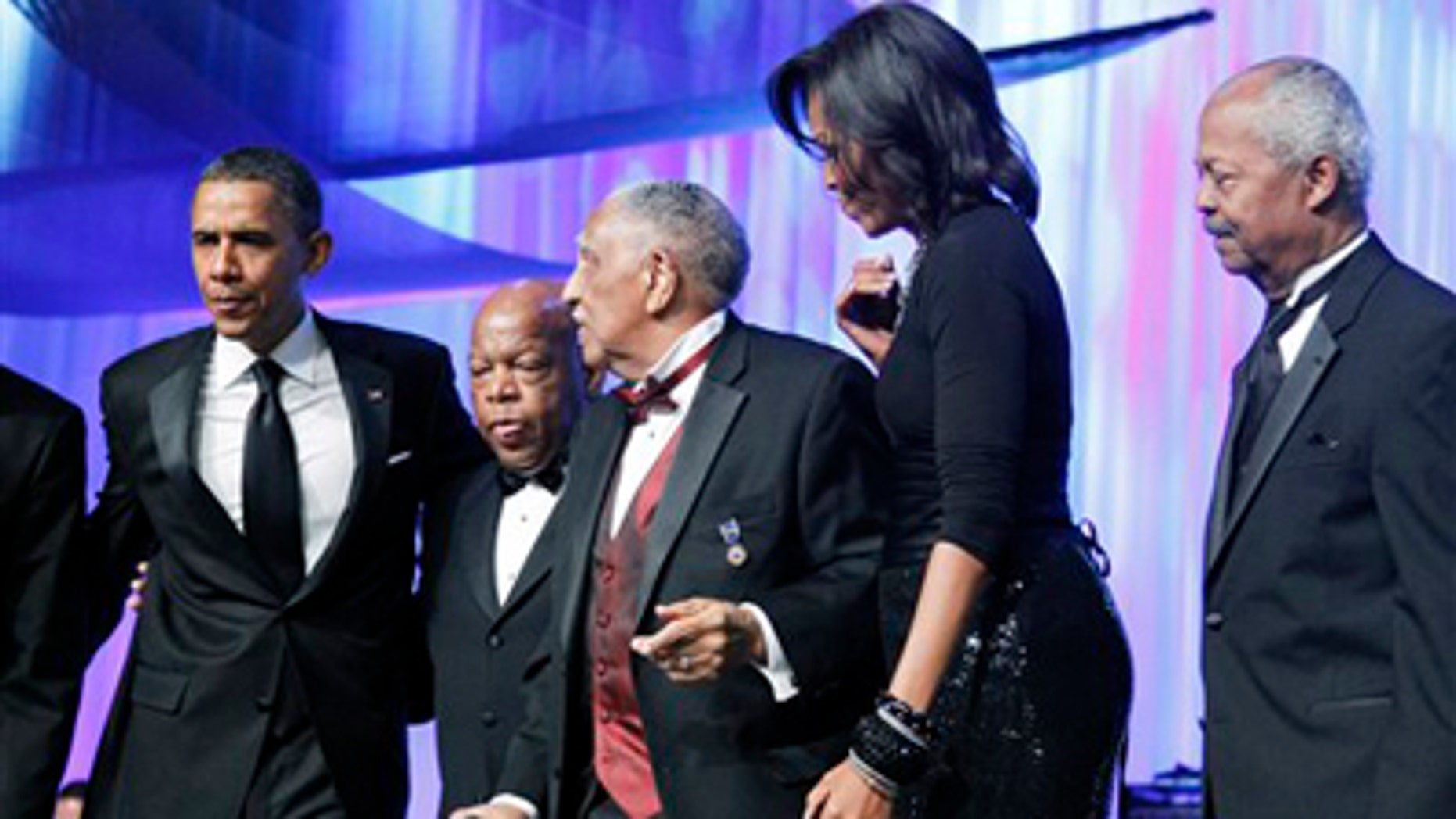 Saturday: President Obama, Rep. John Lewis, D-Ga., civil rights leader Rev. Joseph E. Lowery, first lady Michelle Obama, and CBC Foundation Chairman Rep. Donald M. Payne, D-N.J., stand on-stage during the Congressional Black Caucus Foundation Foundation Annual Phoenix Awards in Washington.