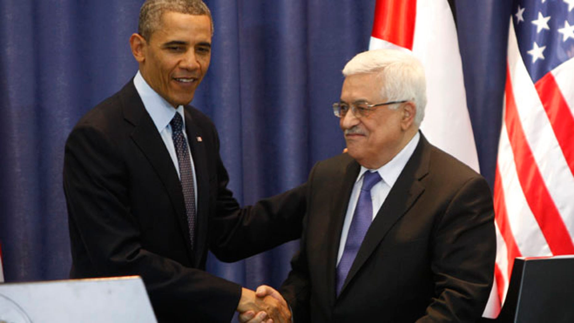 March. 21, 2013: US President Barack Obama, left, shakes hands with Palestinian President Mahmoud Abbas during a joint press conference in the West Bank city of Ramallah. Obama on Thursday urged Israelis and Palestinians to get back to peace talks but offered no new ideas on how they might do so, essentially abandoning his previous support of the Palestinian demand for Israel to halt settlement activity before negotiations resume.